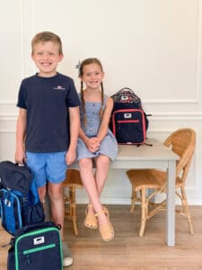 kids with their kindergarten backpacks for back to school