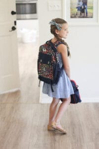 girl with kindergarten backpack