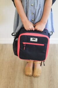 little girl with pink Wanderwild backpack