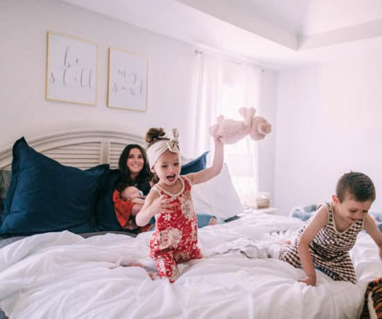 kids jumping on bed