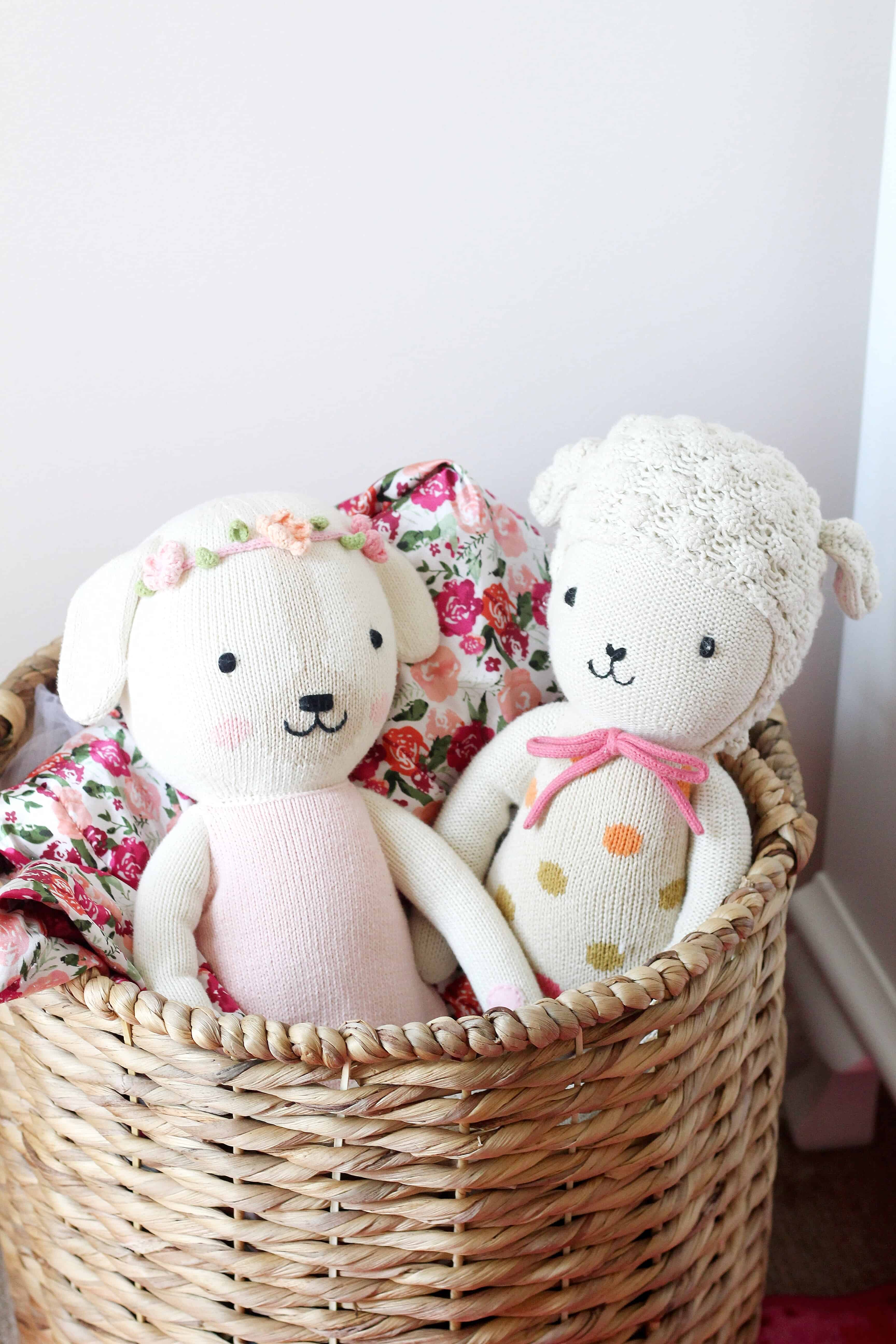 basket with cuddle and kind dolls