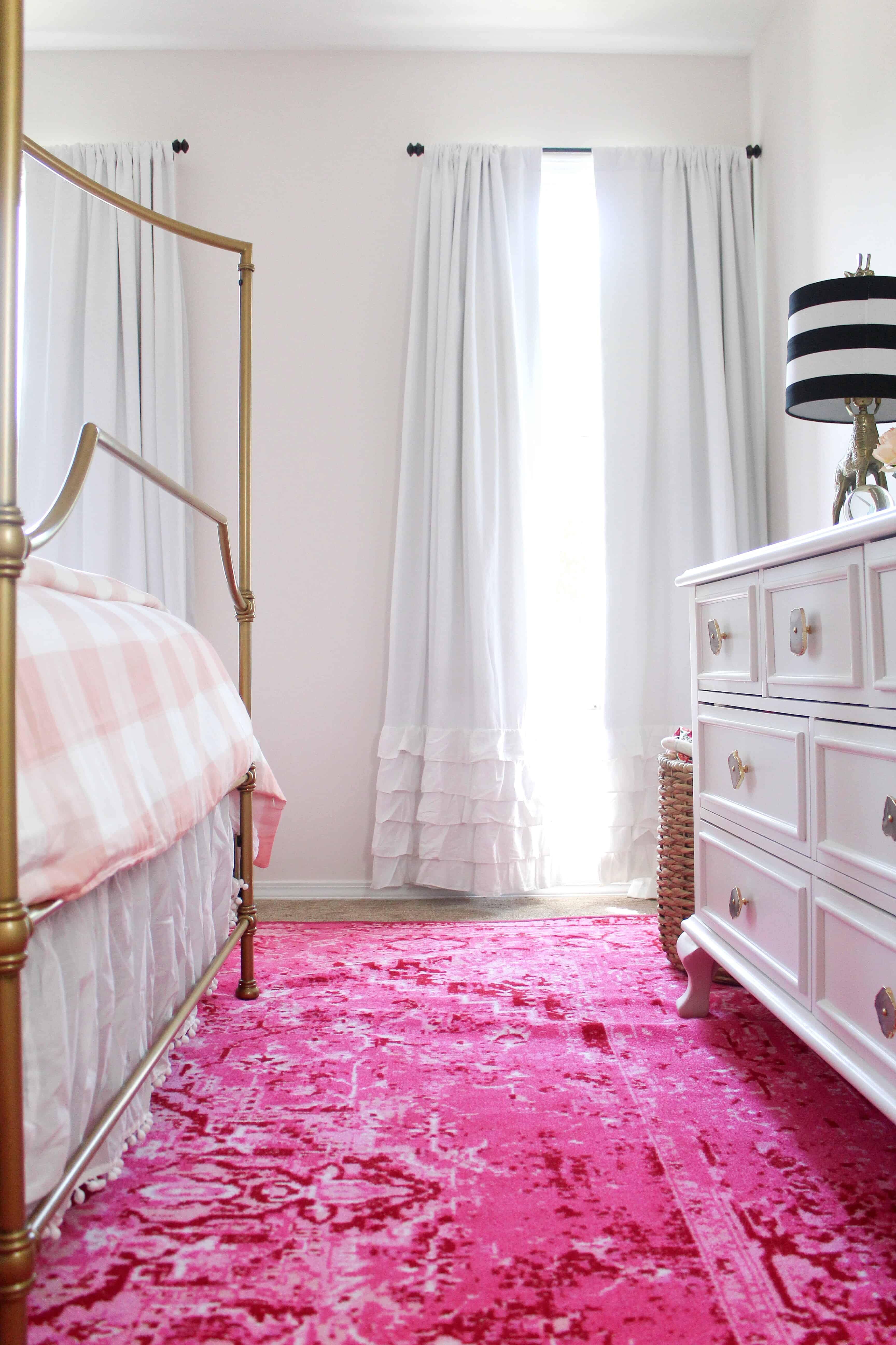 toddler room with hot pink rug