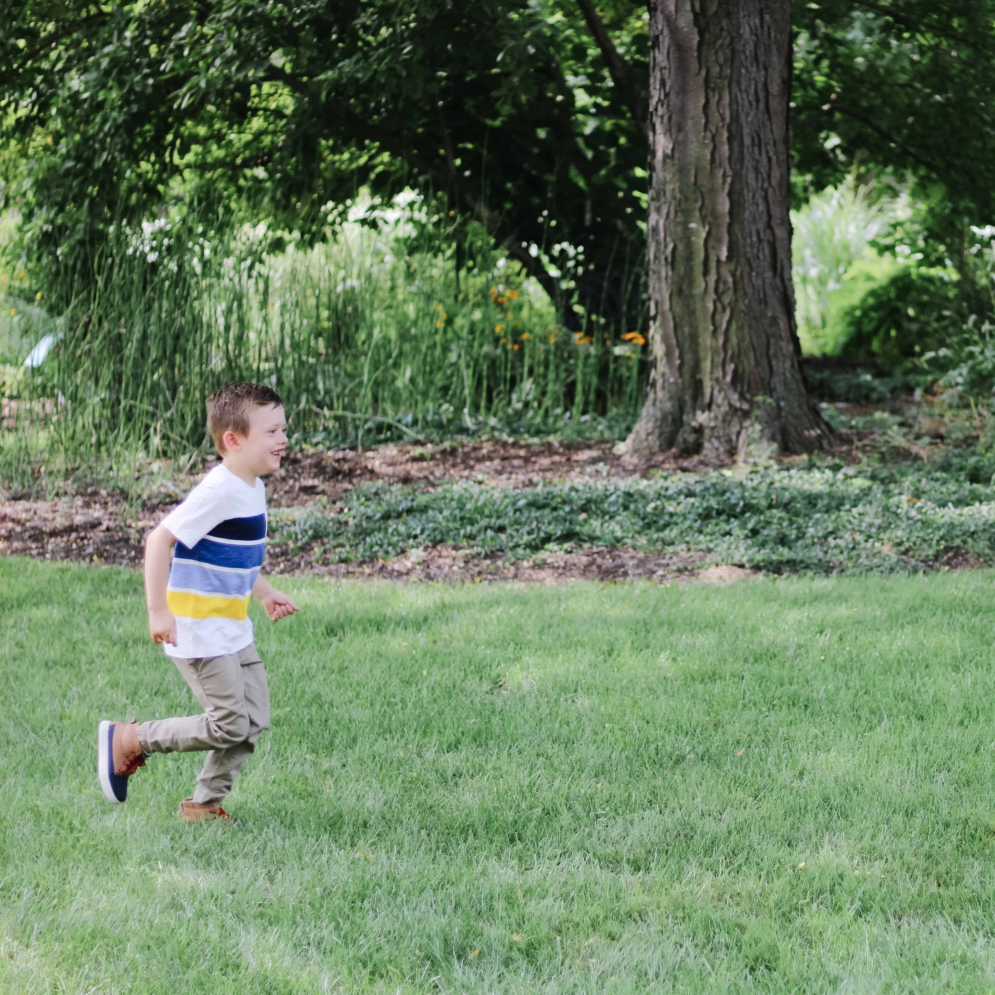 Toddler boy running