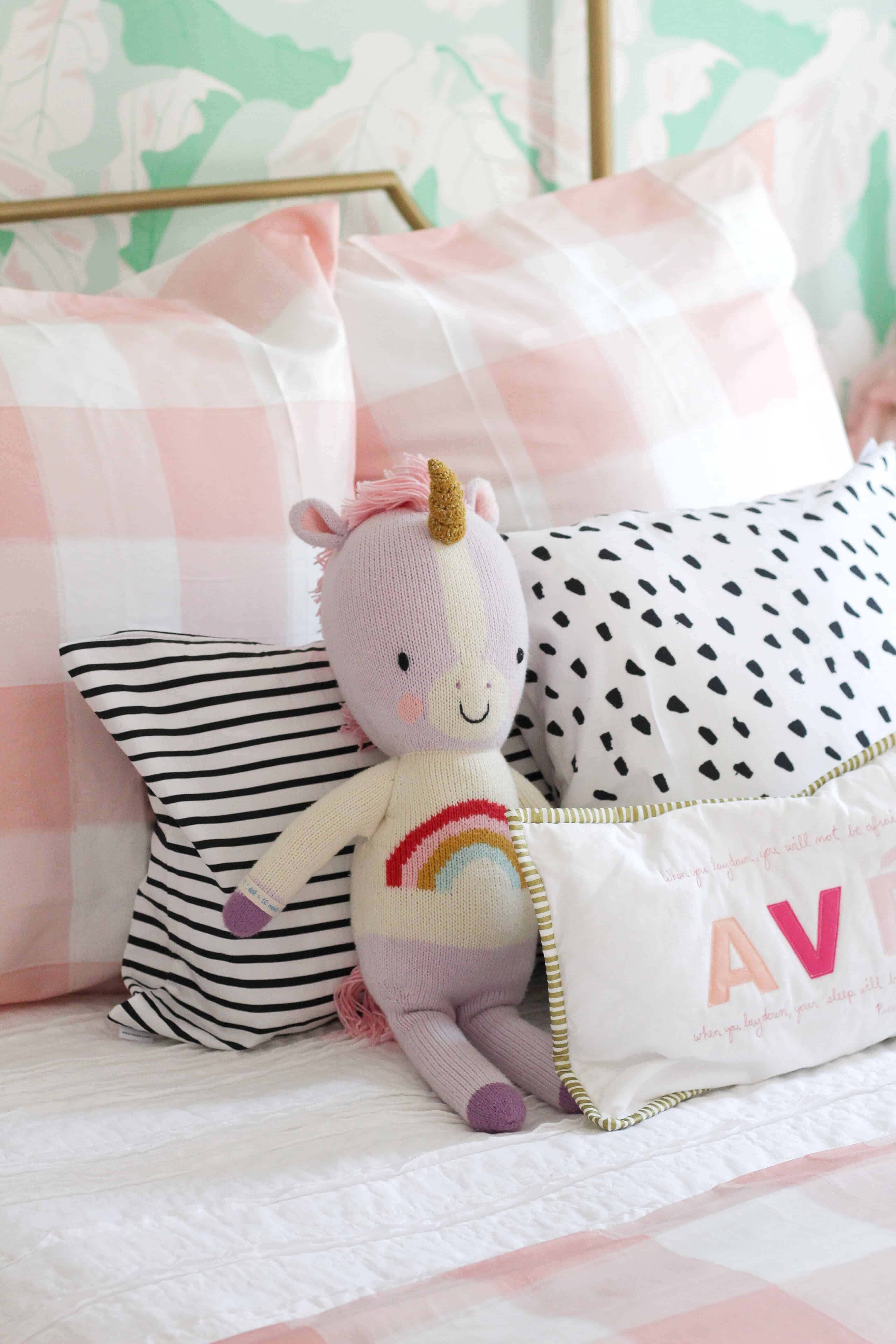 Toddler girl bed with cuddle and kind unicorn