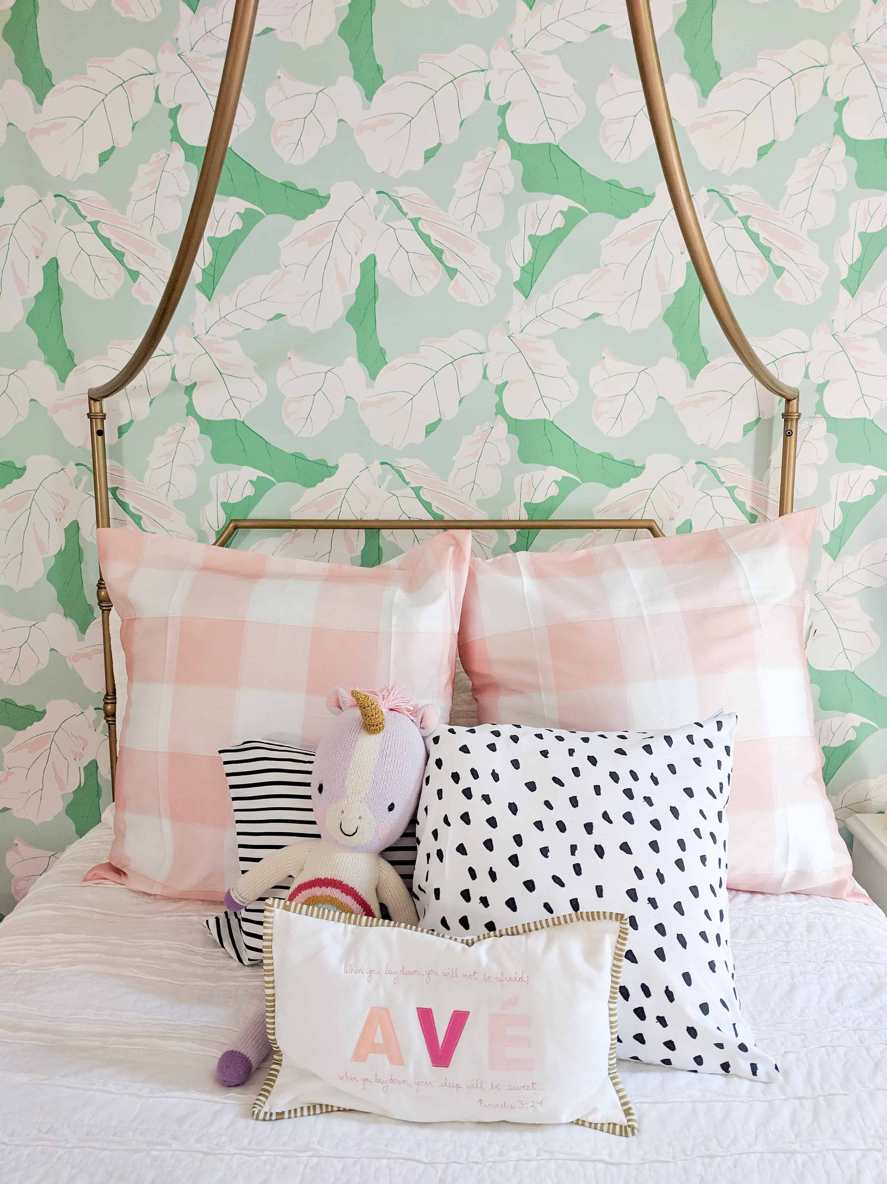 toddler girl room with pink and green wallpaper