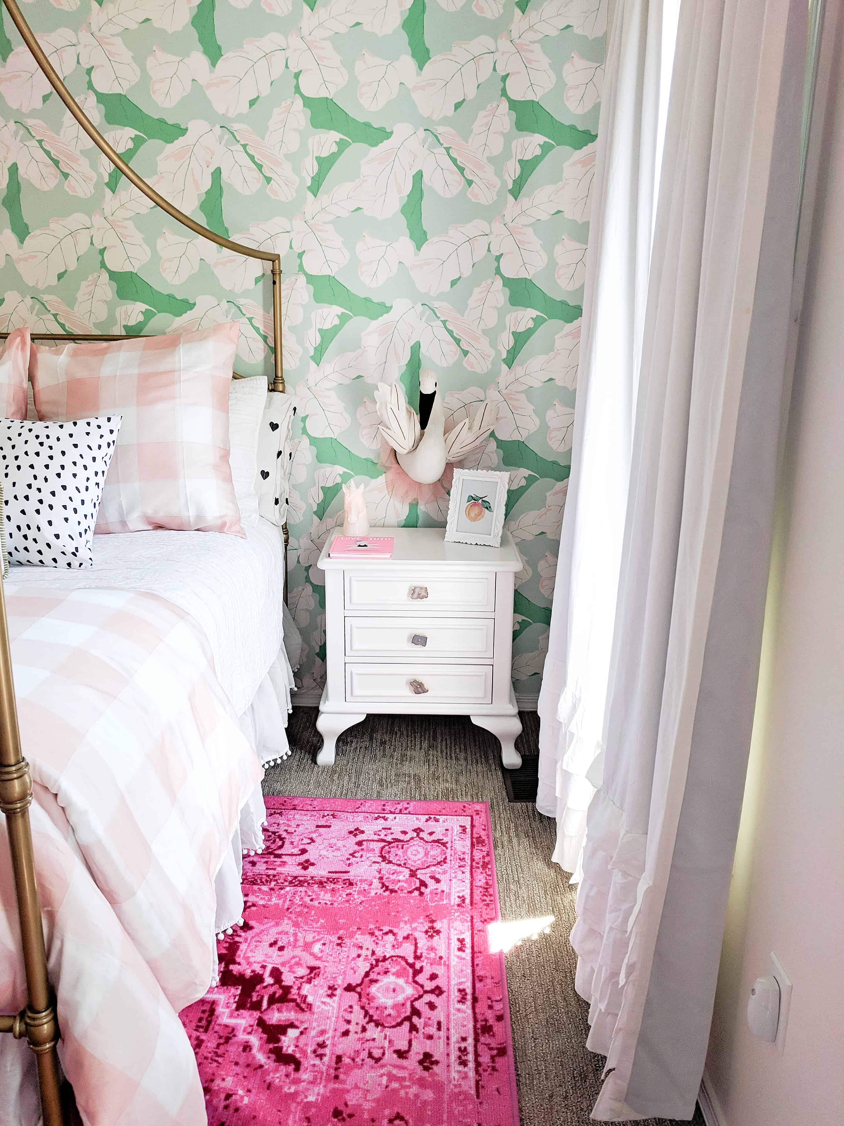 toddler girl room with white green and pink wallpaper