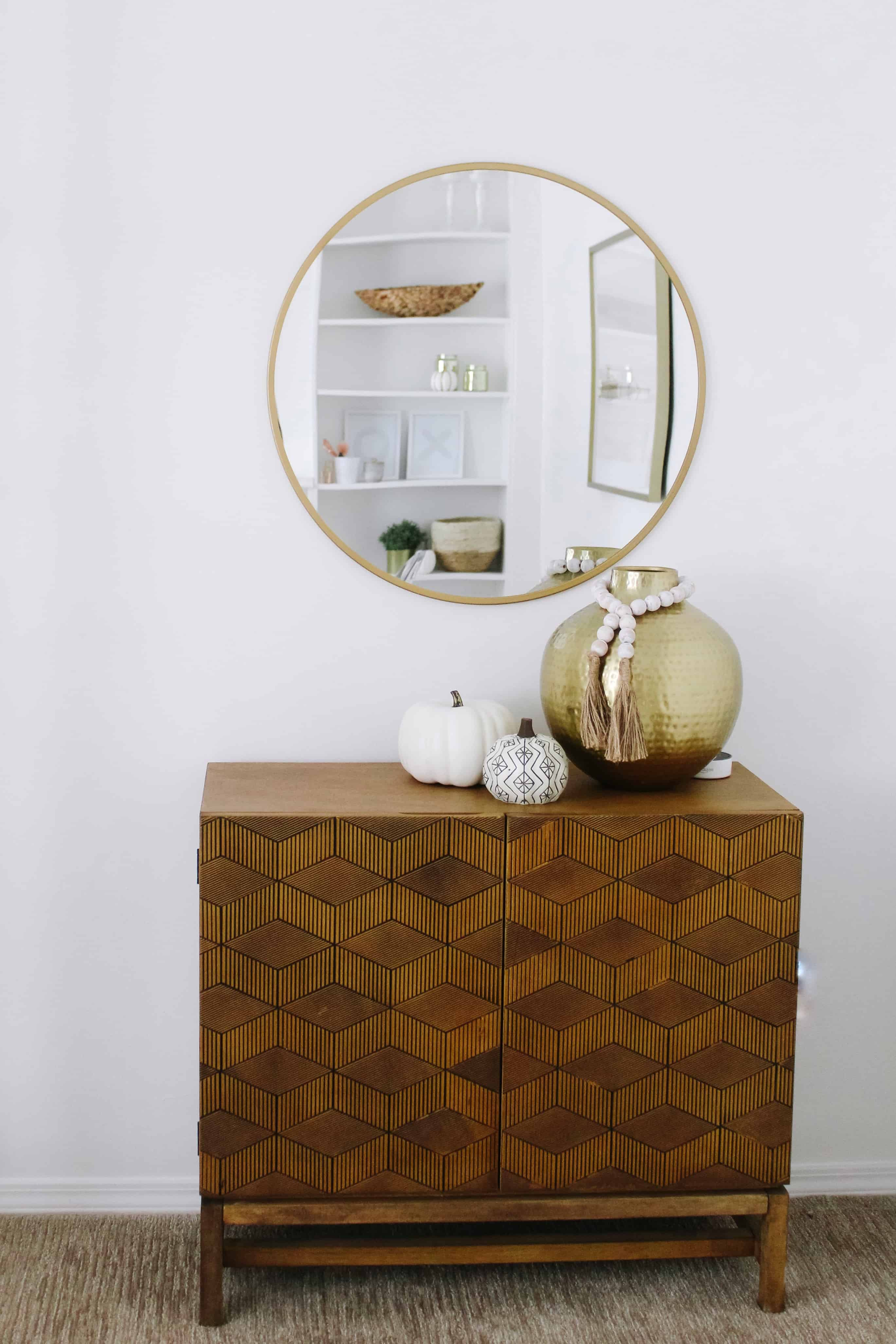 modern buffet with round mirror over