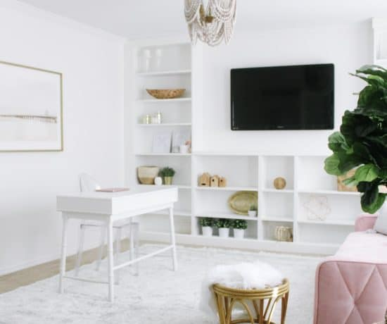 bright white home office with pink couch