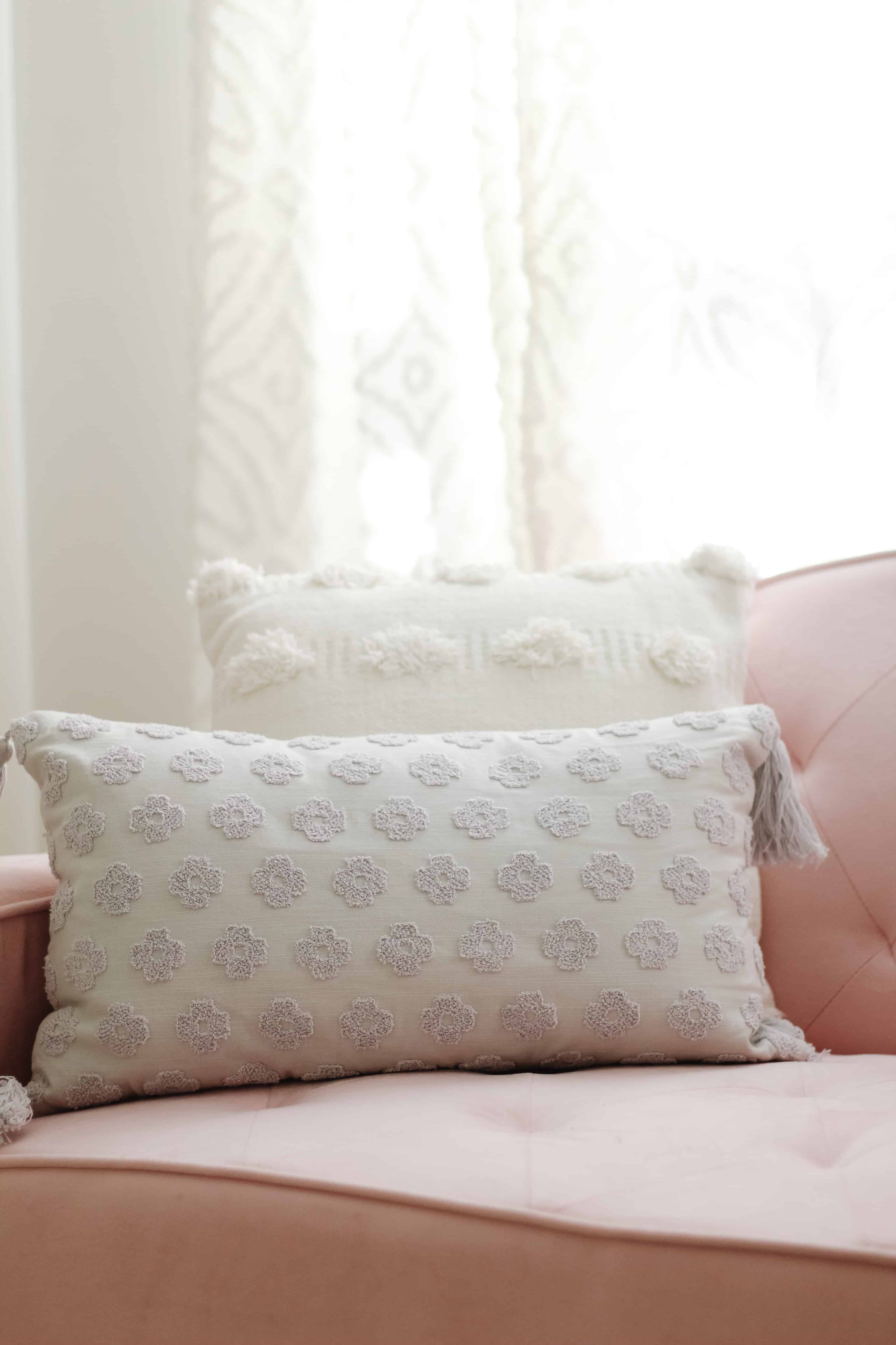 Layered Pillows on pink couch