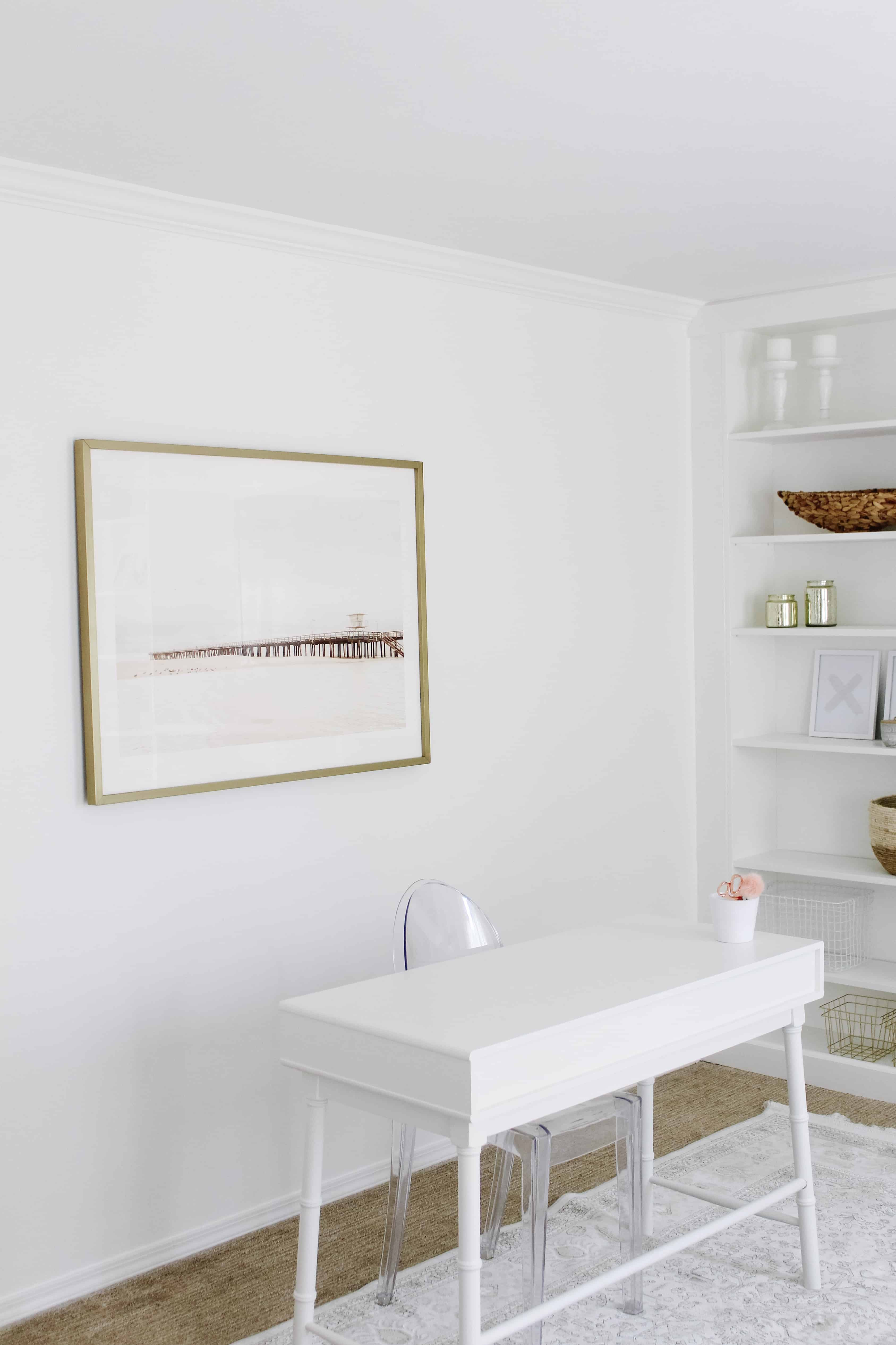 Minted Art over white desk