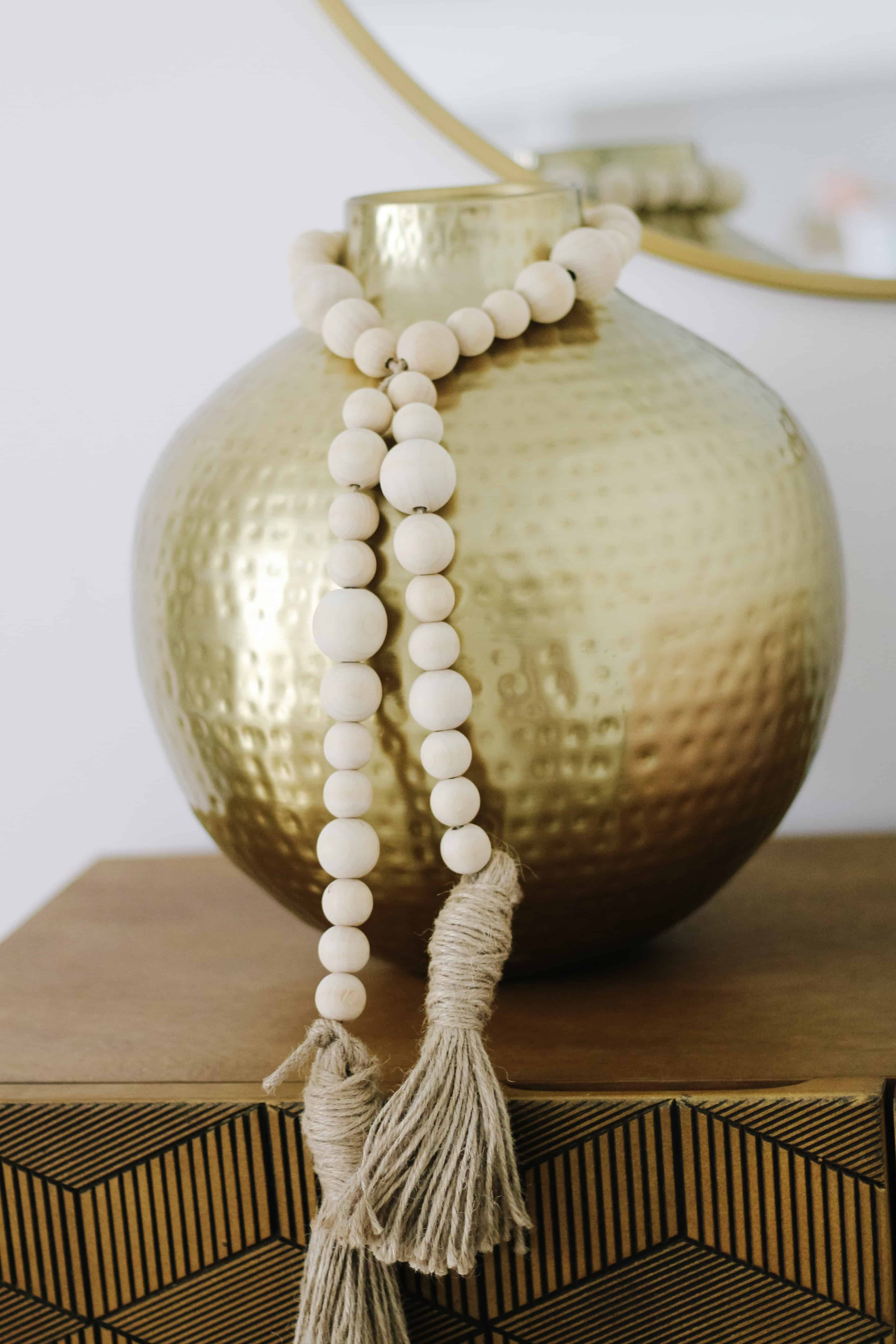 wood beads on gold vase