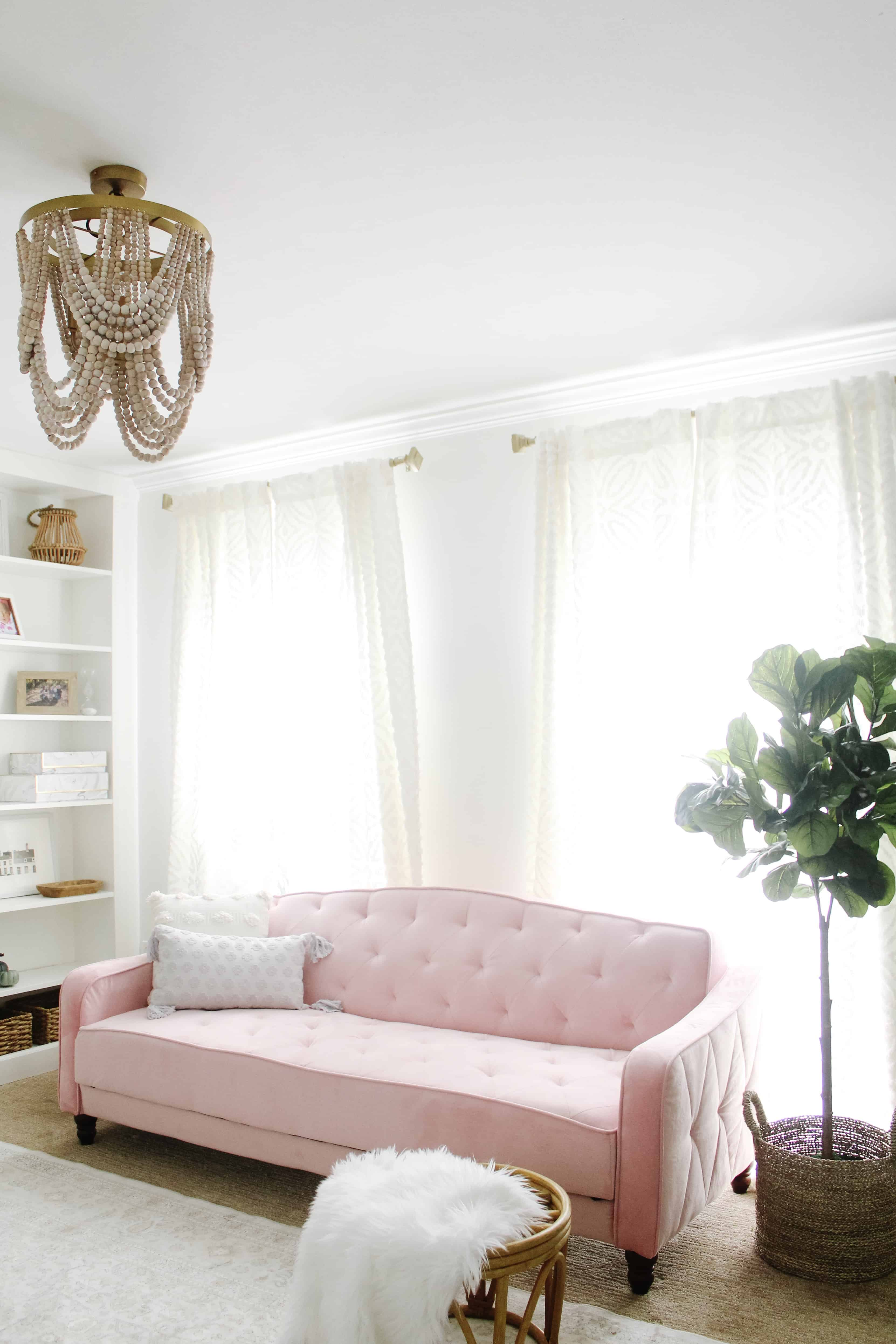 pink couch in home office