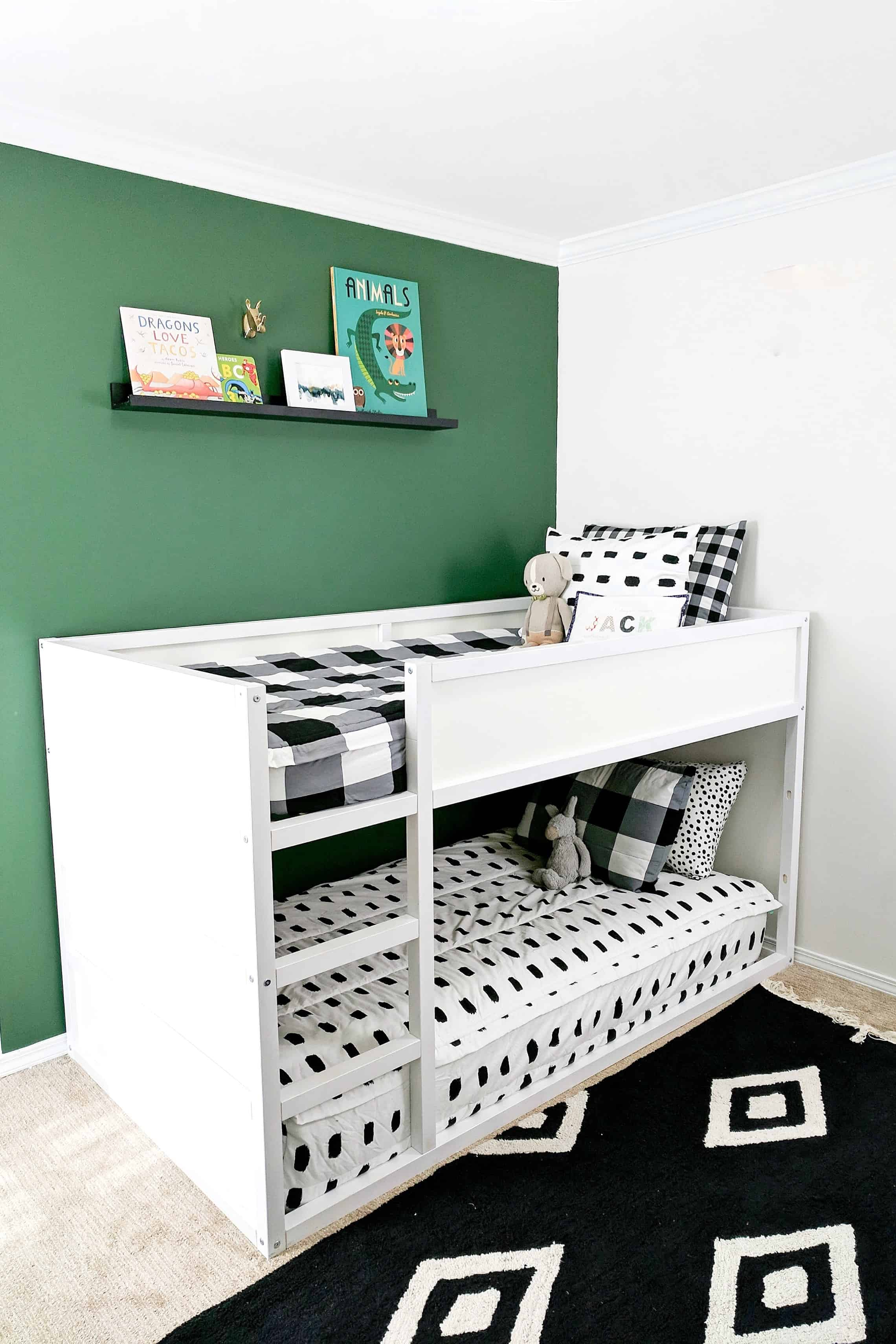 ikea bunk beds against green wall
