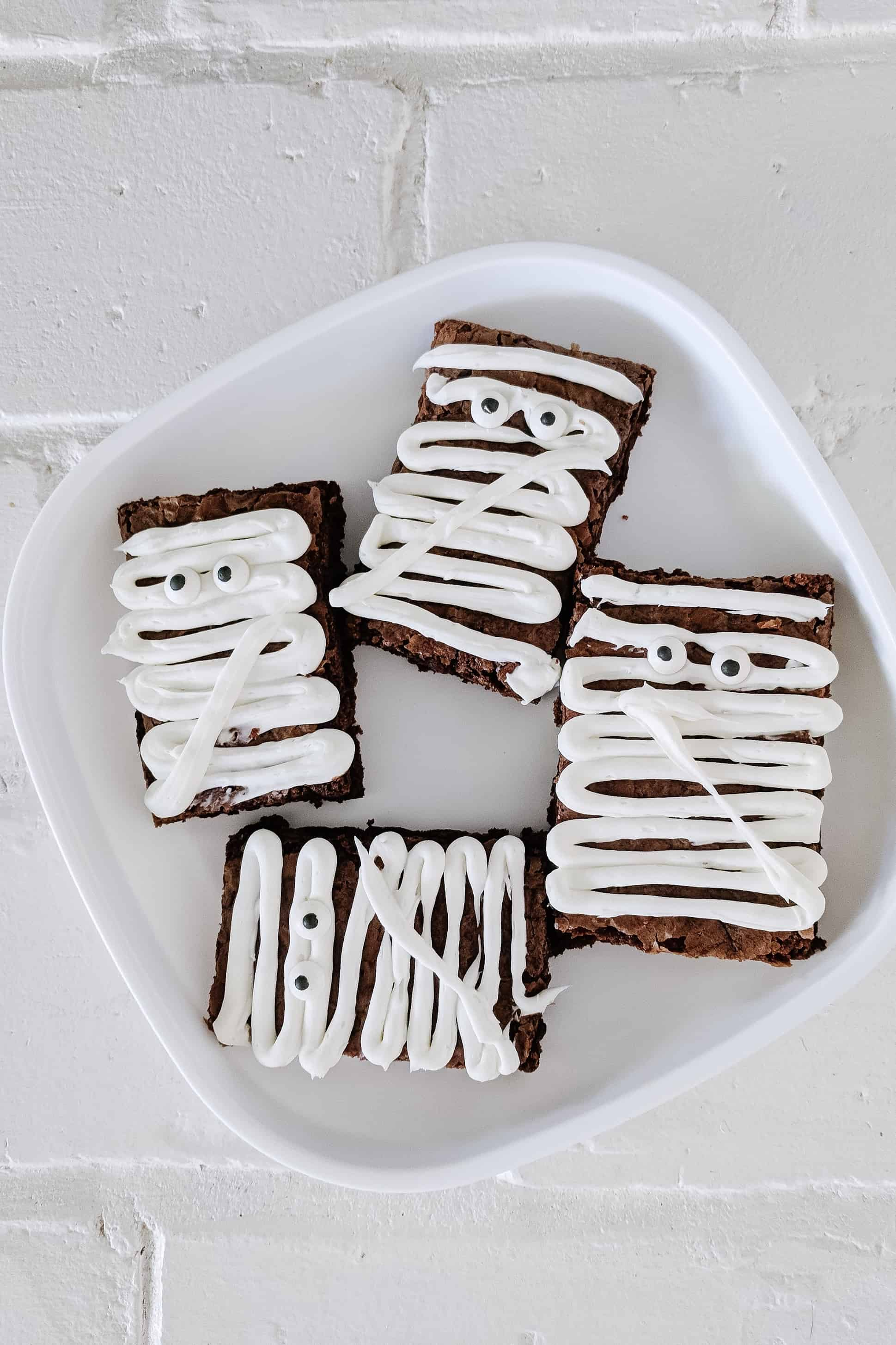 mummy brownies on a white plate