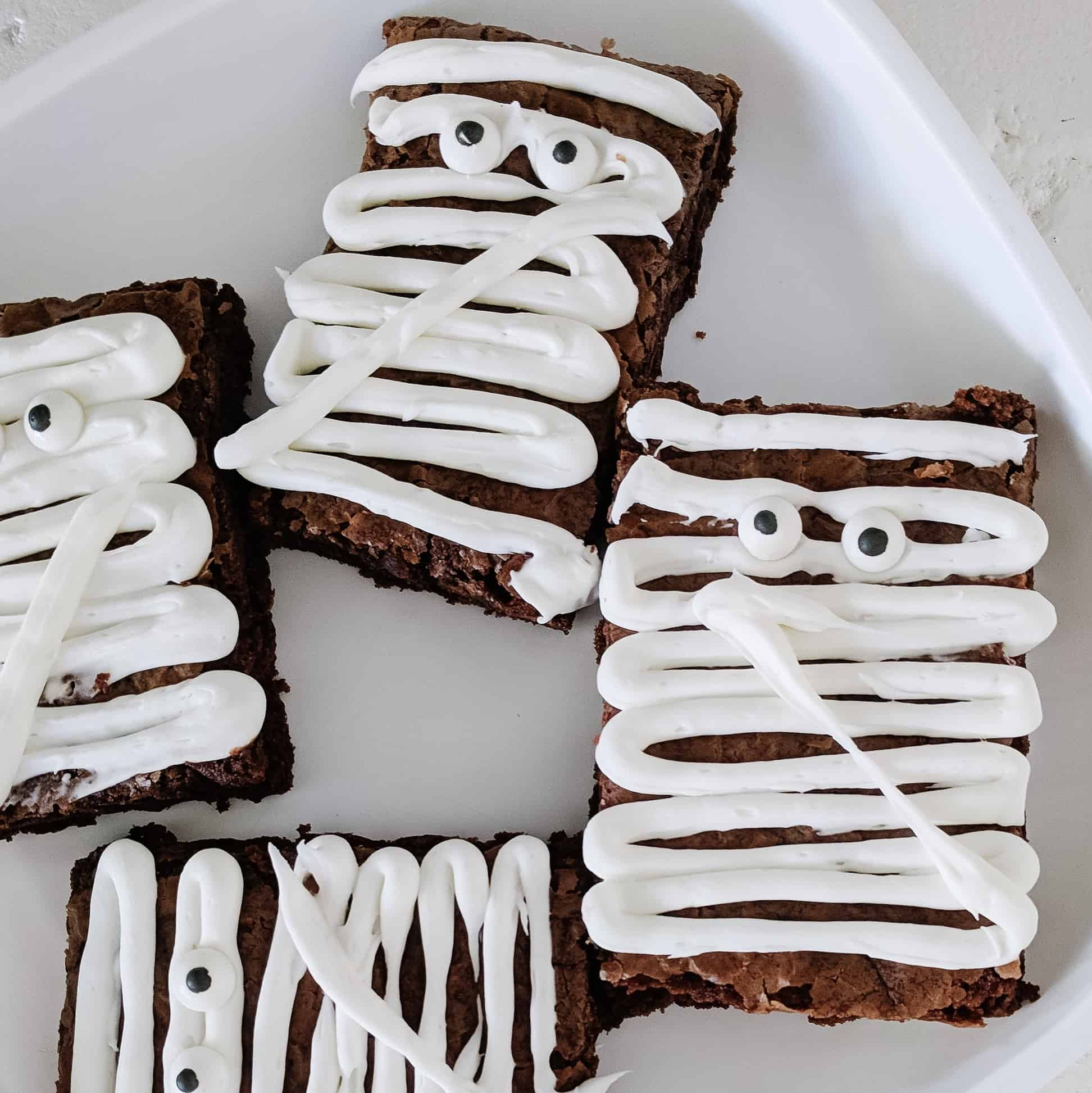 Mummy brownies on white plate