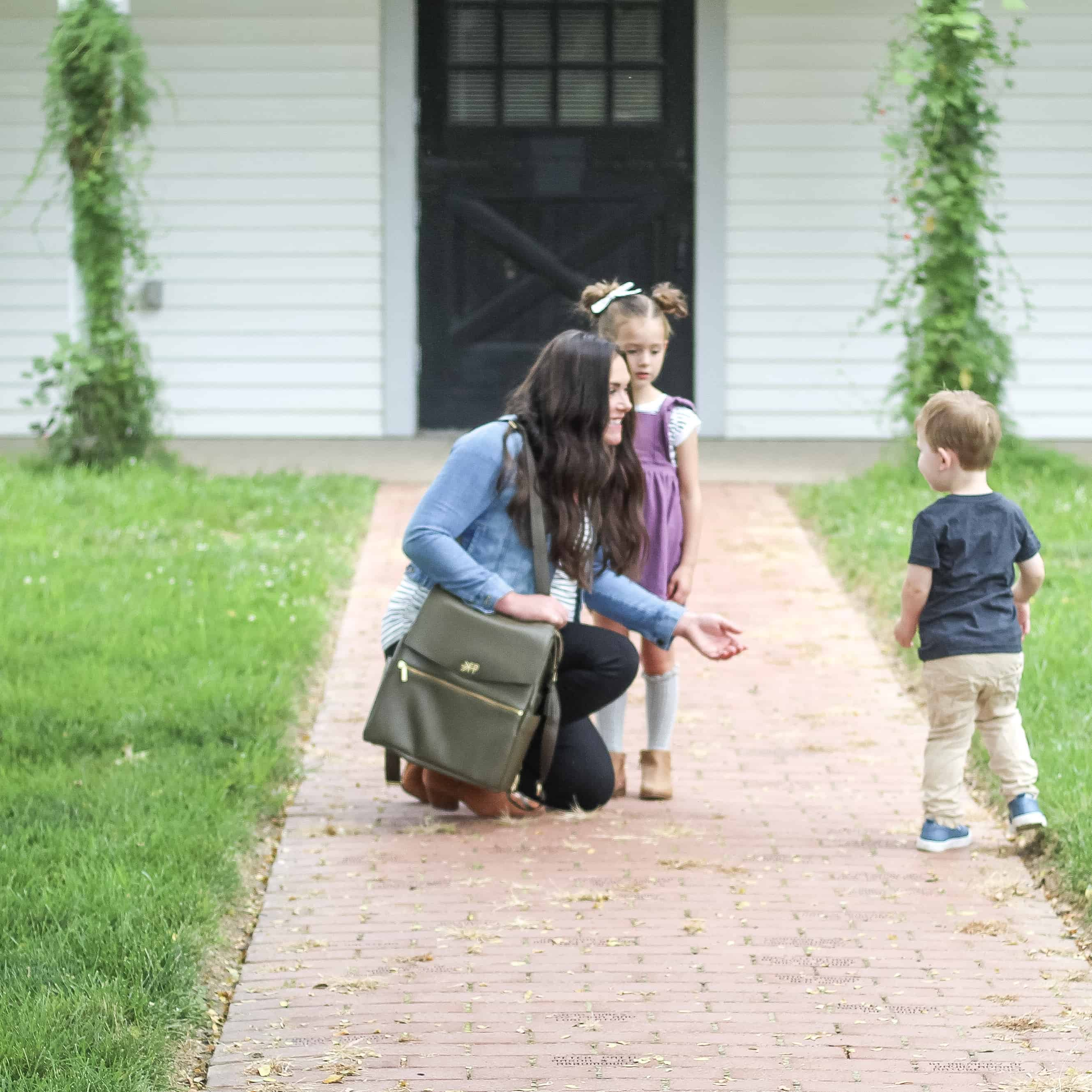 mom with 2 kids and olive freshly picked diaper bag