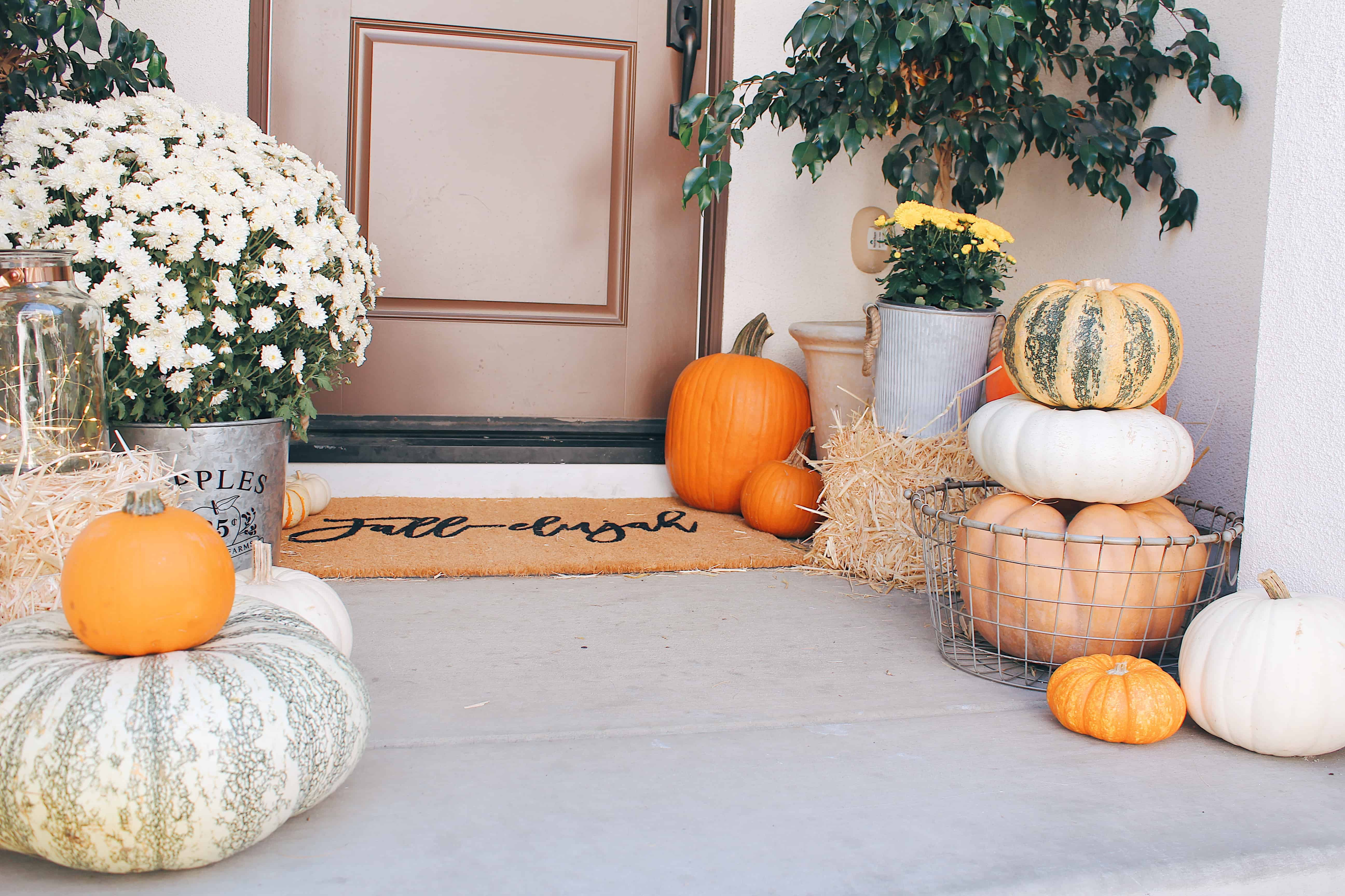 classic fall front porch with brown door