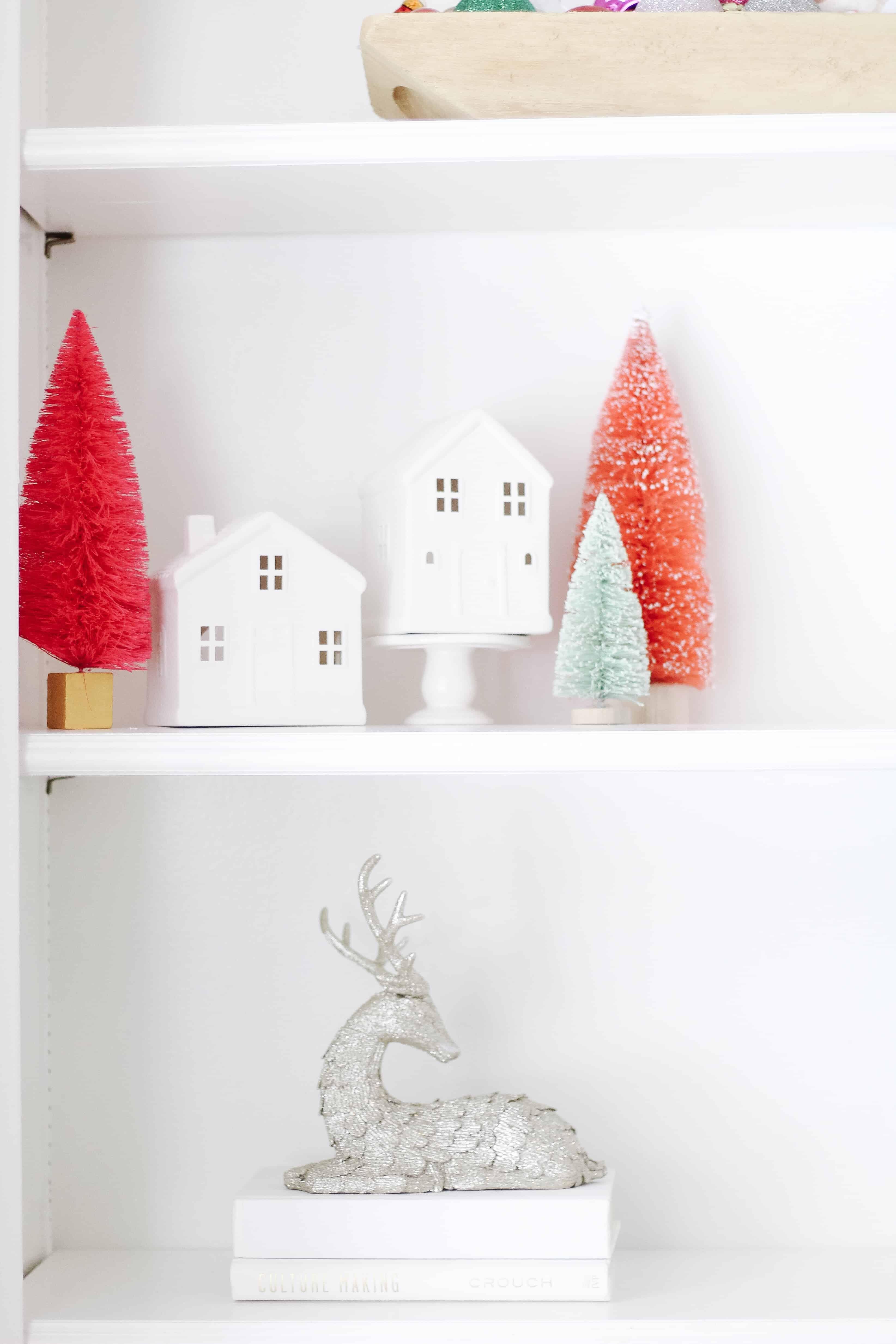 Bottle brush trees and white houses