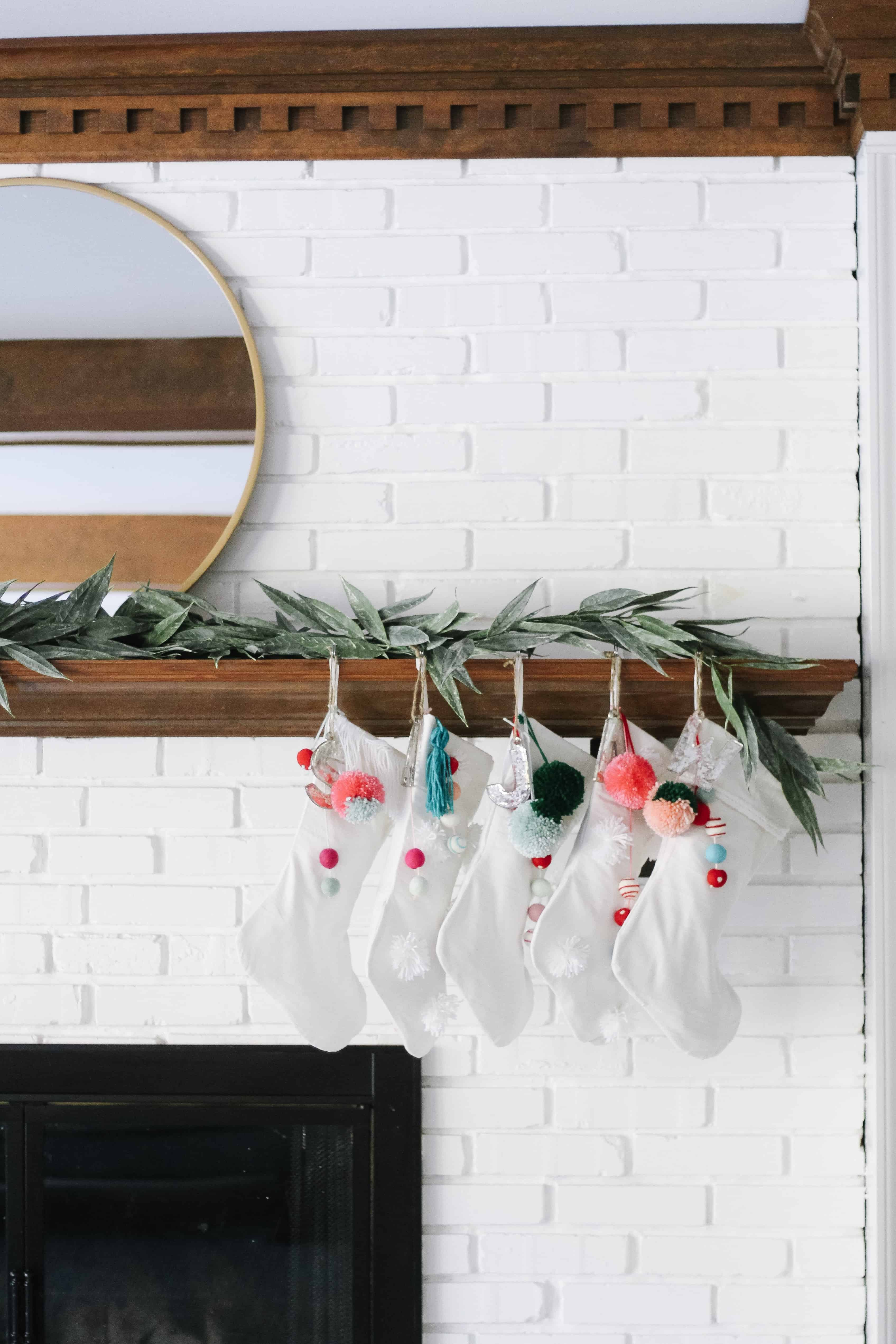 white stockings hung with colorful poms