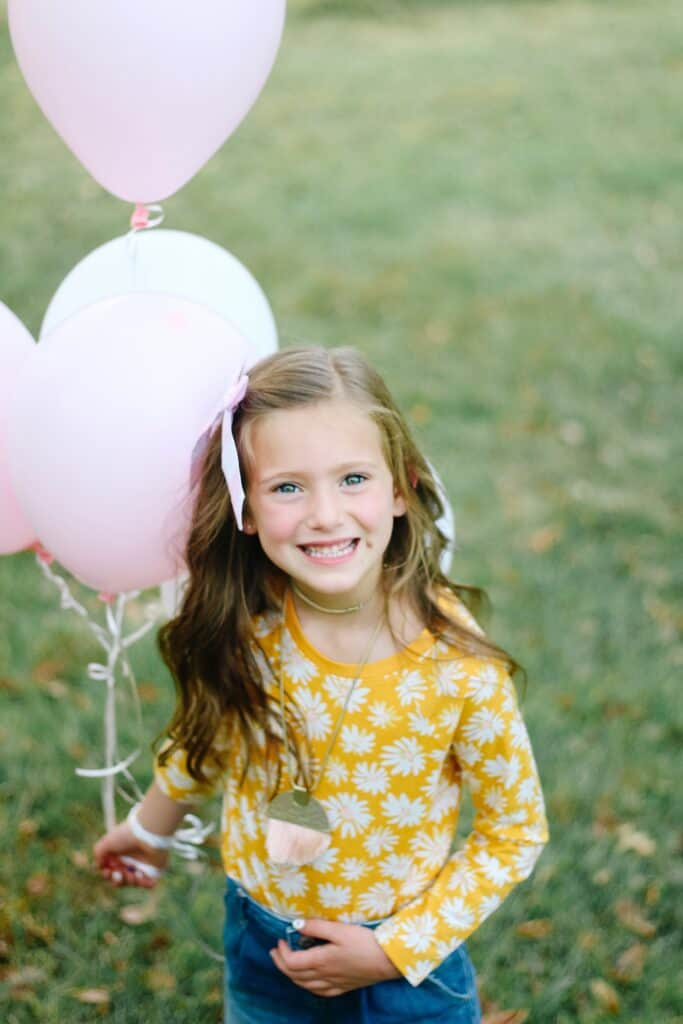 6 year old girl with balloons