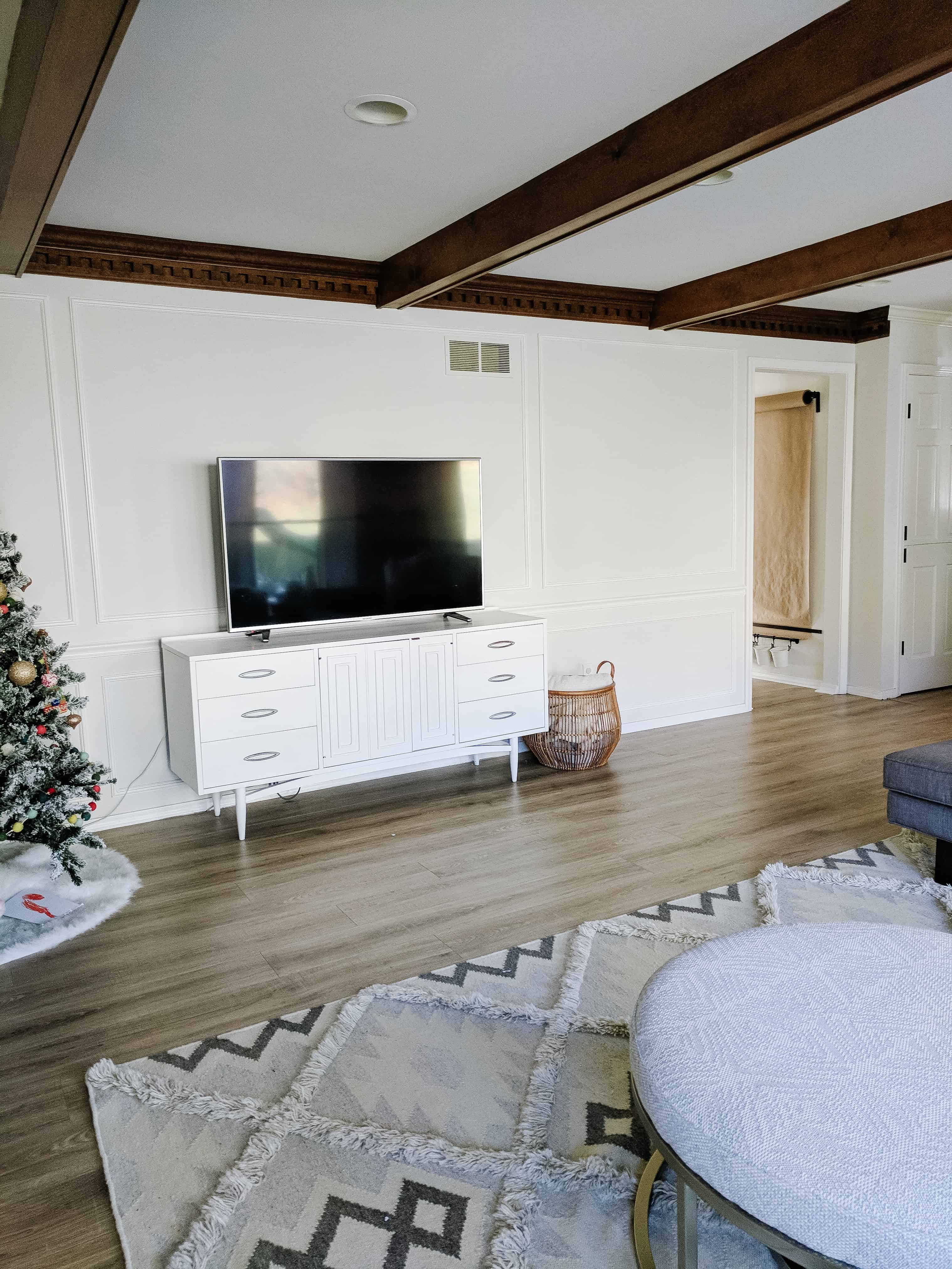 living room with mid century tv stand