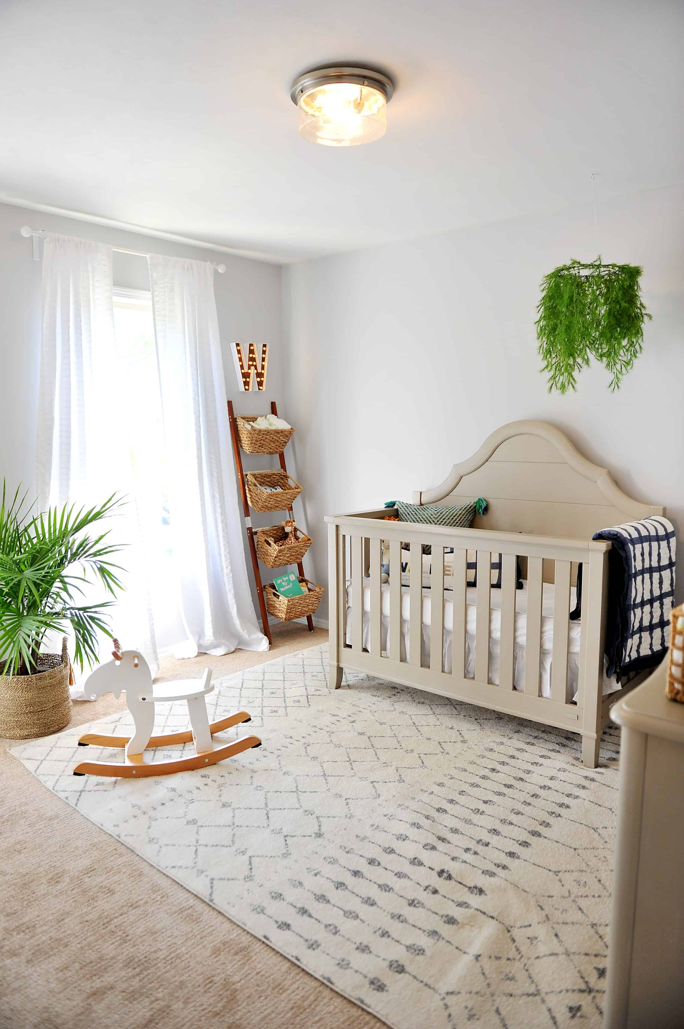 nursery with grey walls and green and navy pops