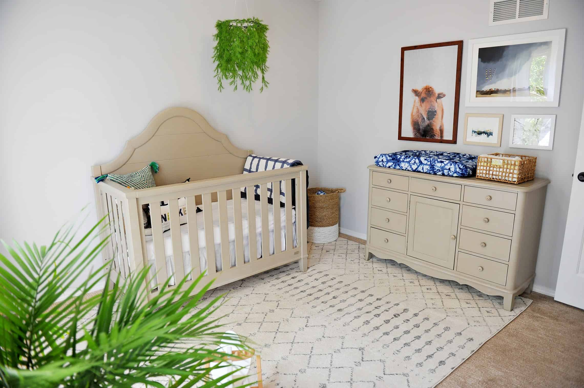 Modern nursery with greenery mobile