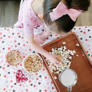 Toddler helping make valentine's day snack