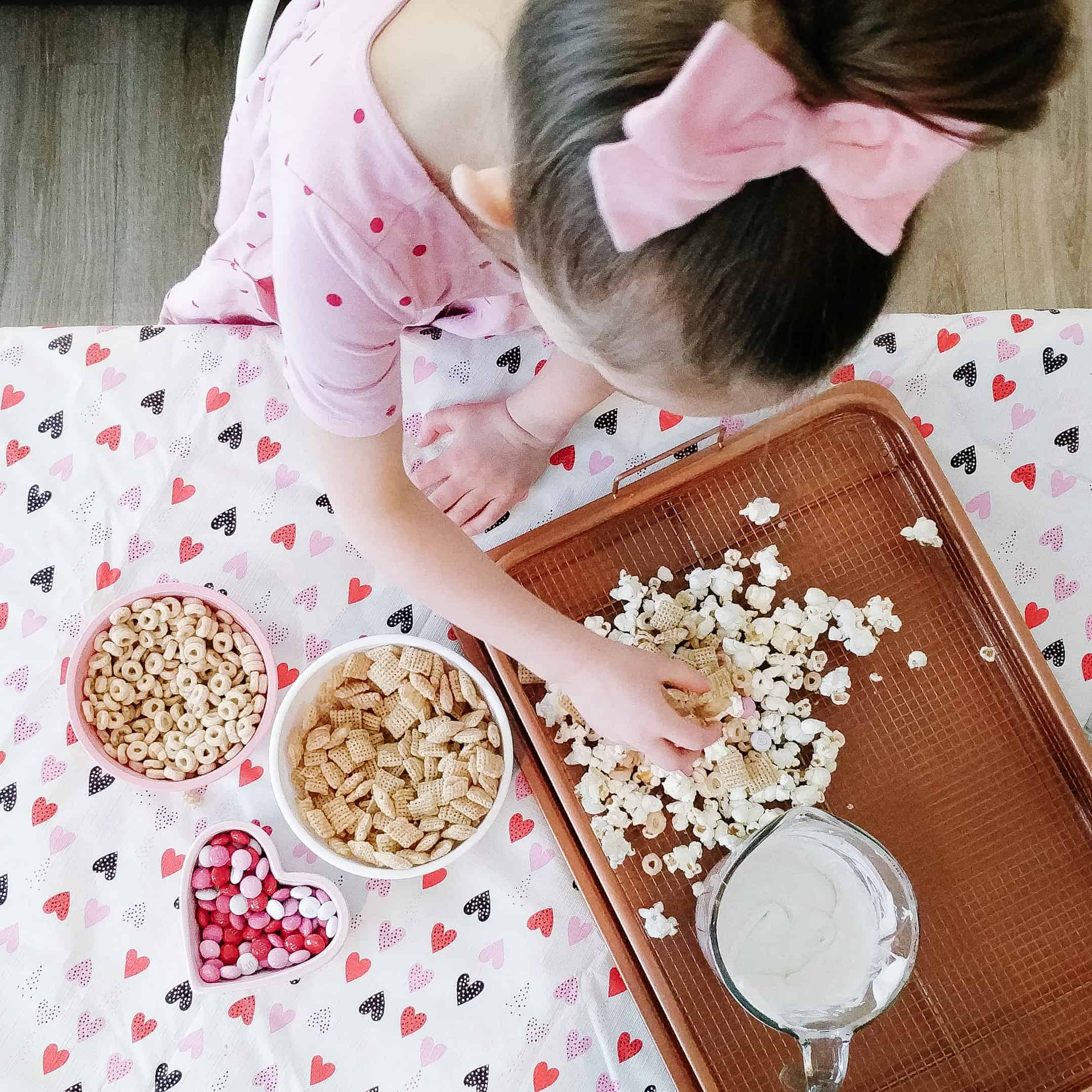 Toddler helping make valentine's day snack
