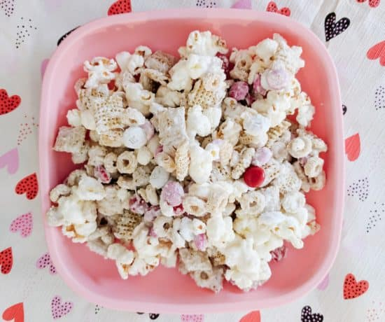Best Toddler Valentines Day snack on a pink plate over a heart table cloth