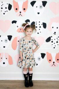 little girl In puppy themed dress