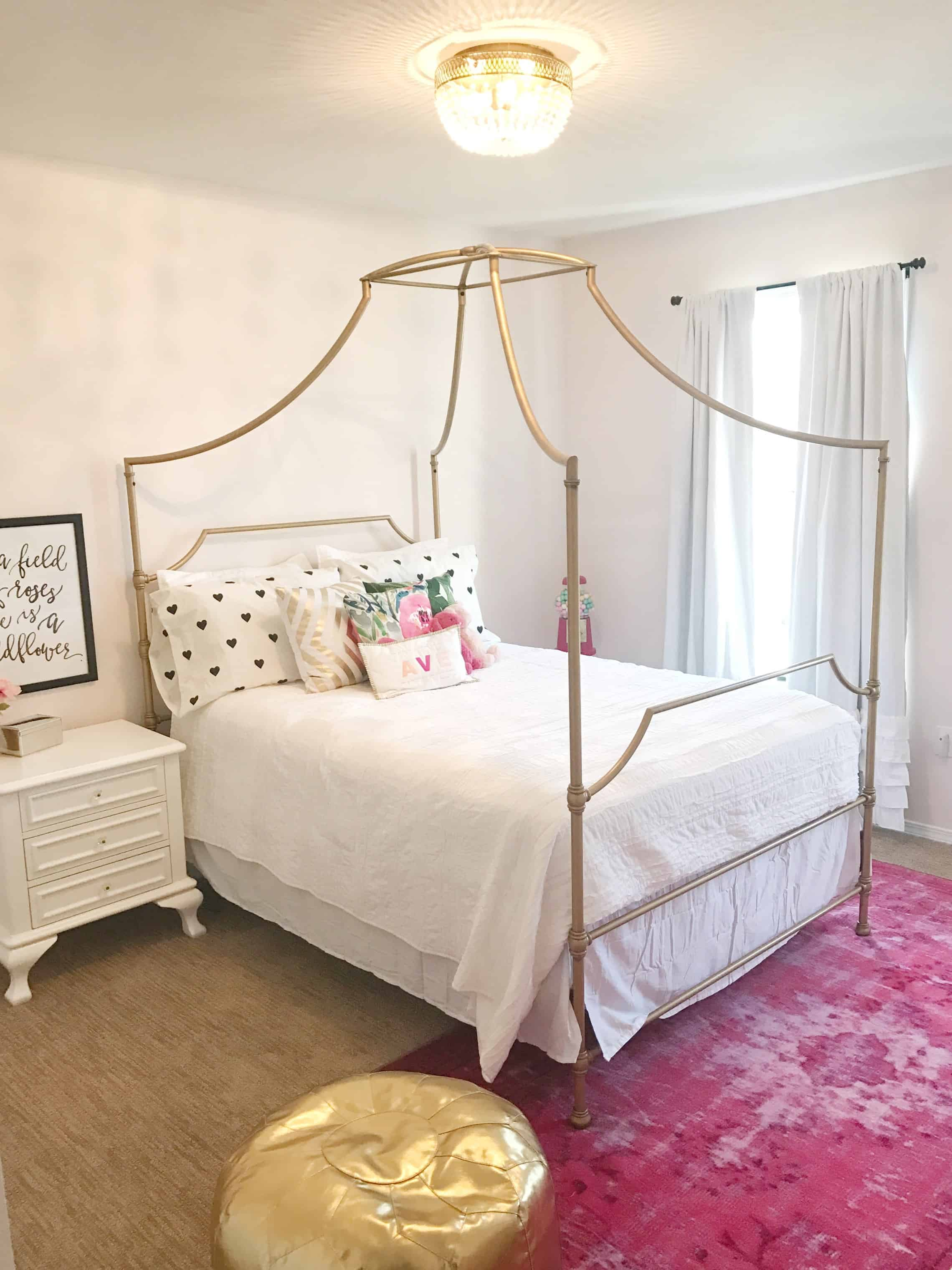 PB teen mason bed styled with white bedding and pink rug