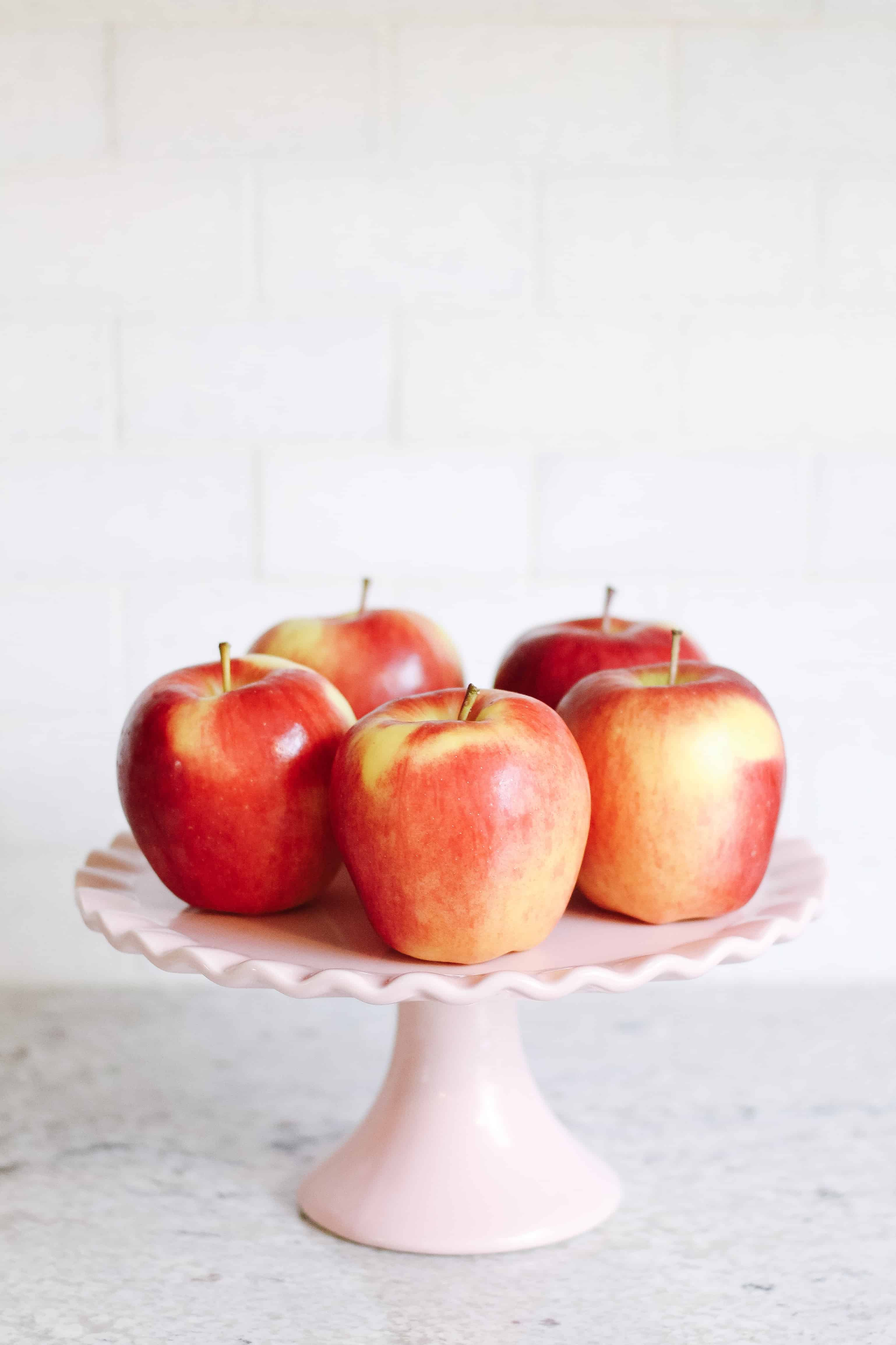 Apples on pink cake stand