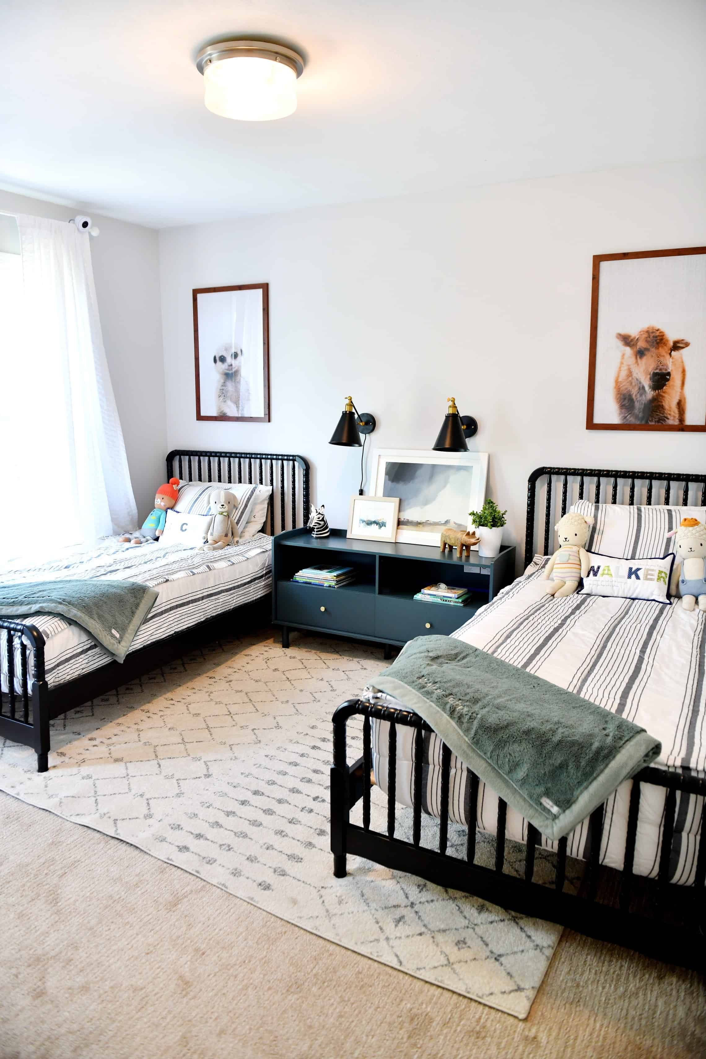 photo of shared boys room with two black Jenny Lind beds