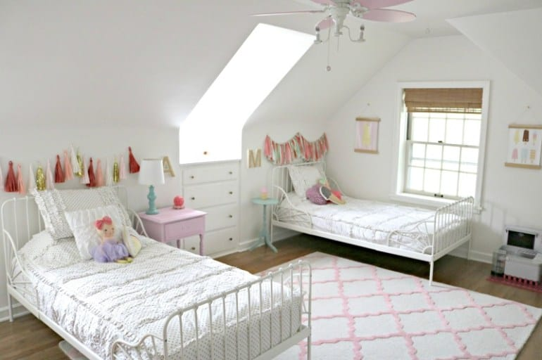 two white Ikea twin beds in a little girl bedroom