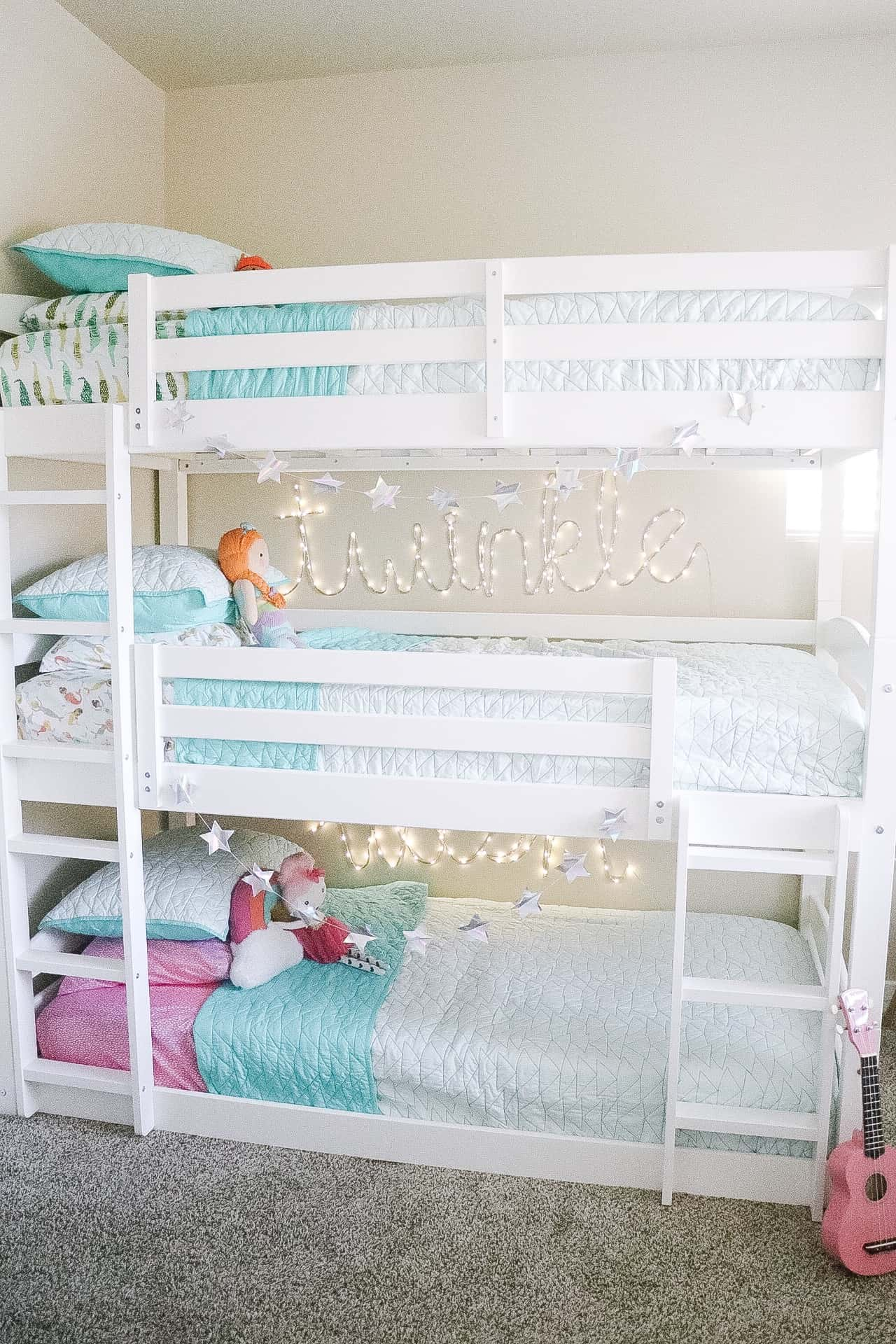 triple bunk beds in a room for siblings