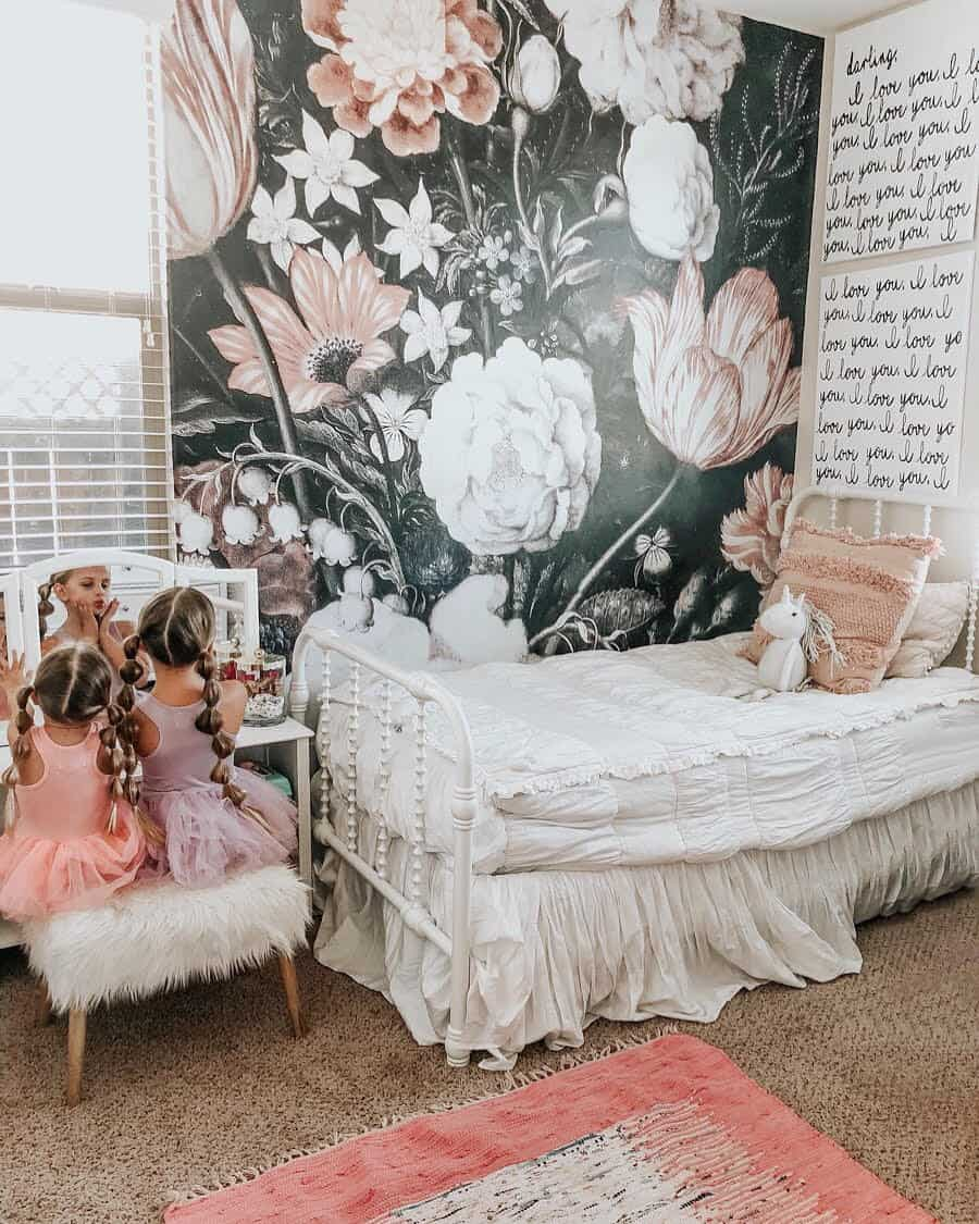toddler girl room with black and floral wallpaper