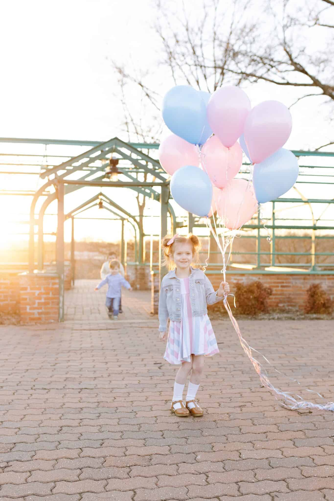 baby girl tis blue and pink balloons