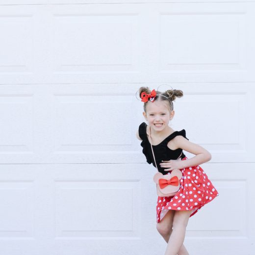 Little Girl dressed for Disney in red and white skirt and black leotard