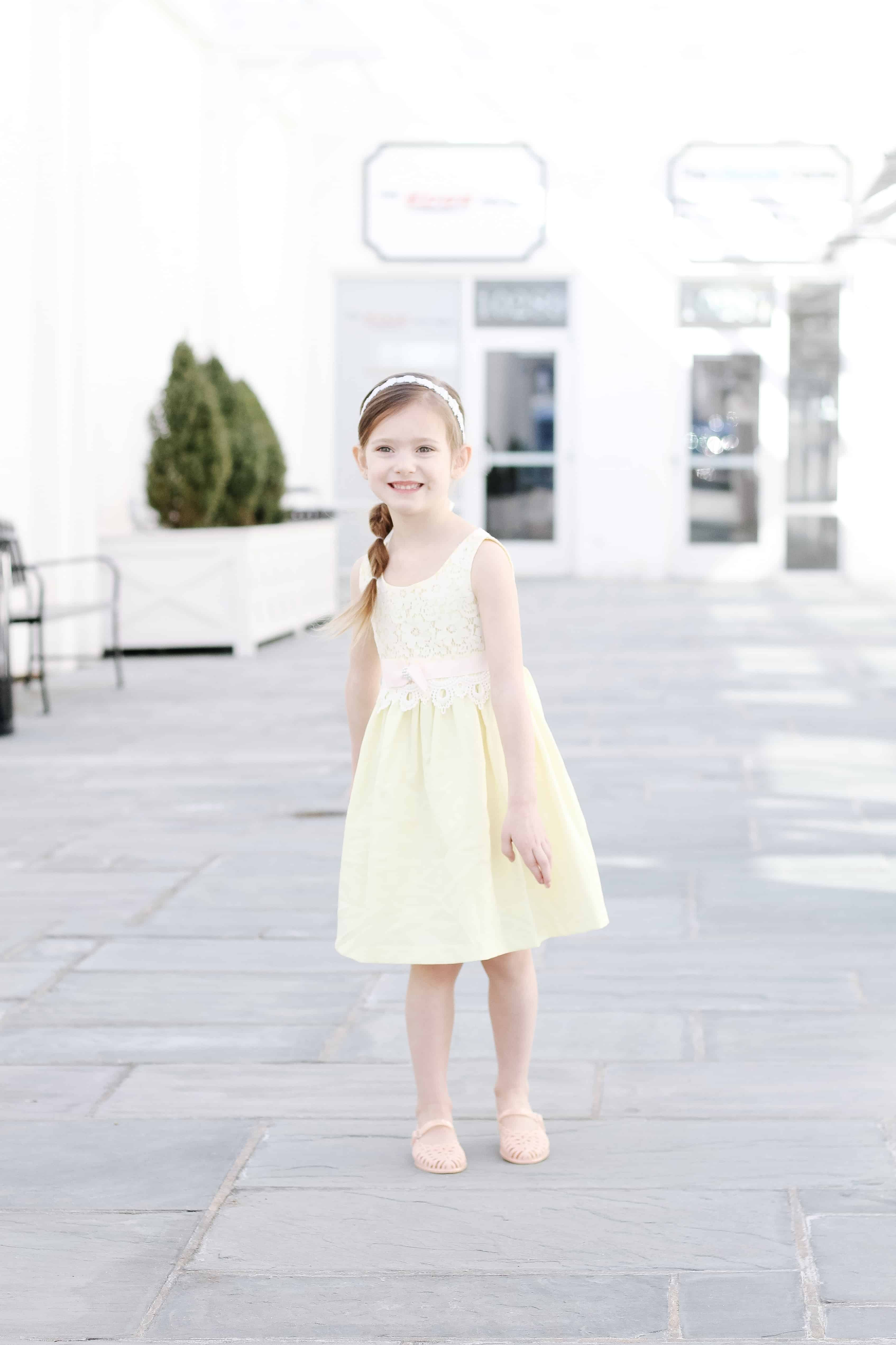 Toddler girl in yellow Easter Dress