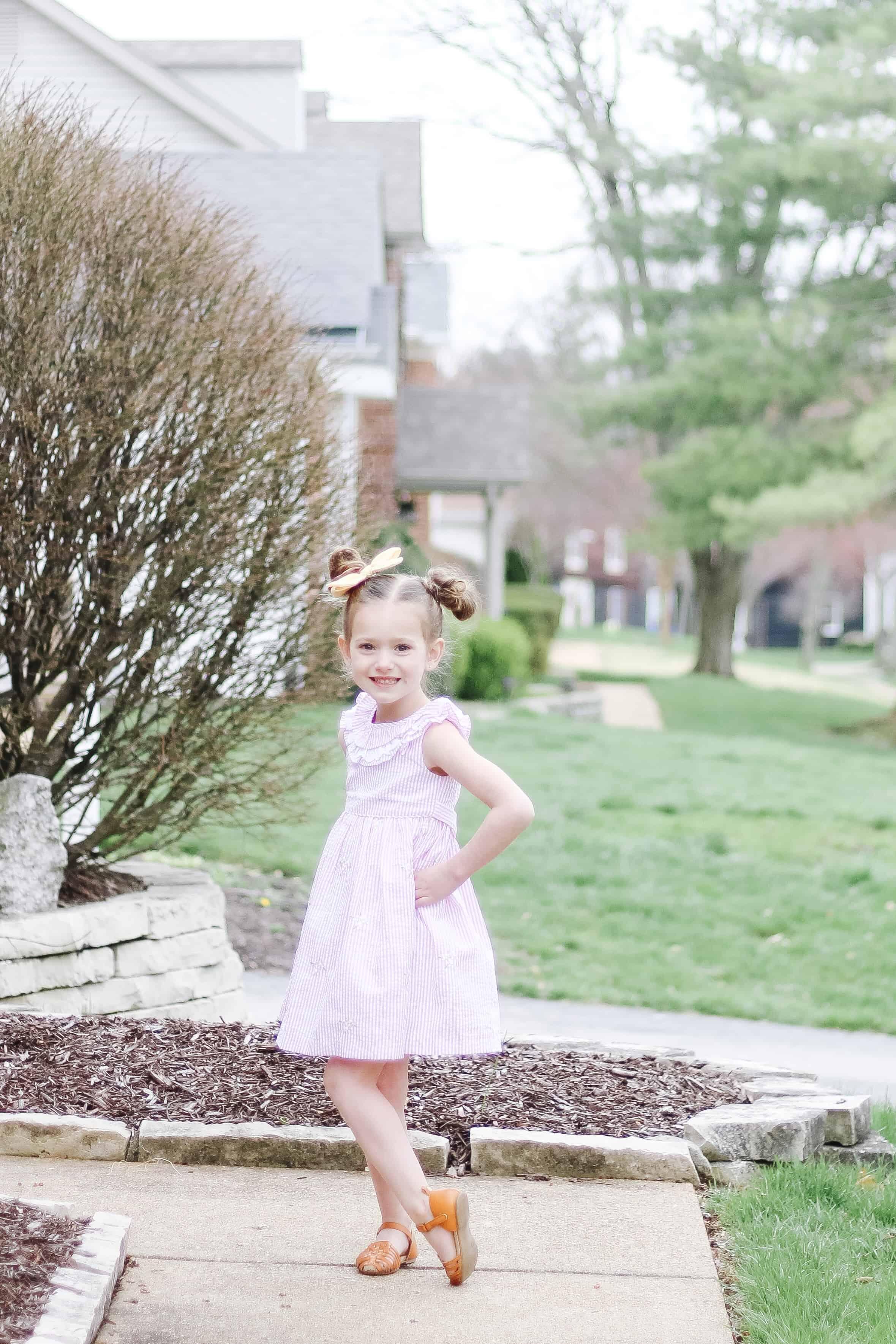 Pink seersucker dress on toddler girl