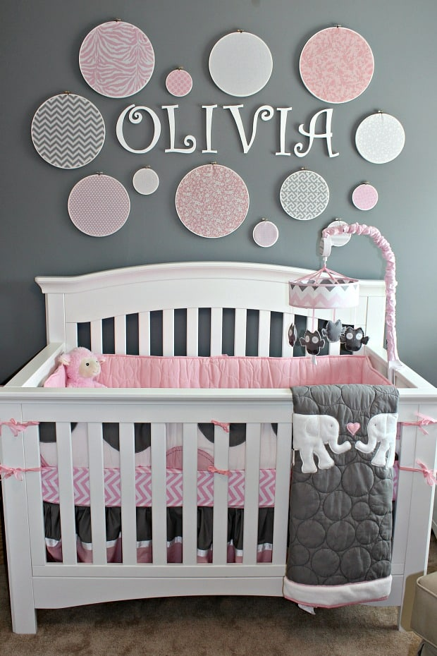 Grey Nursery with embroidery hoop wall and name over crib