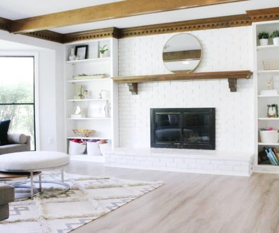 photo of living room with large white brick fireplace