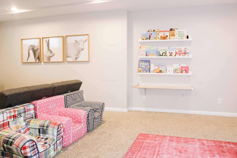 Arlo Ultra Monitor on playroom bookshelves