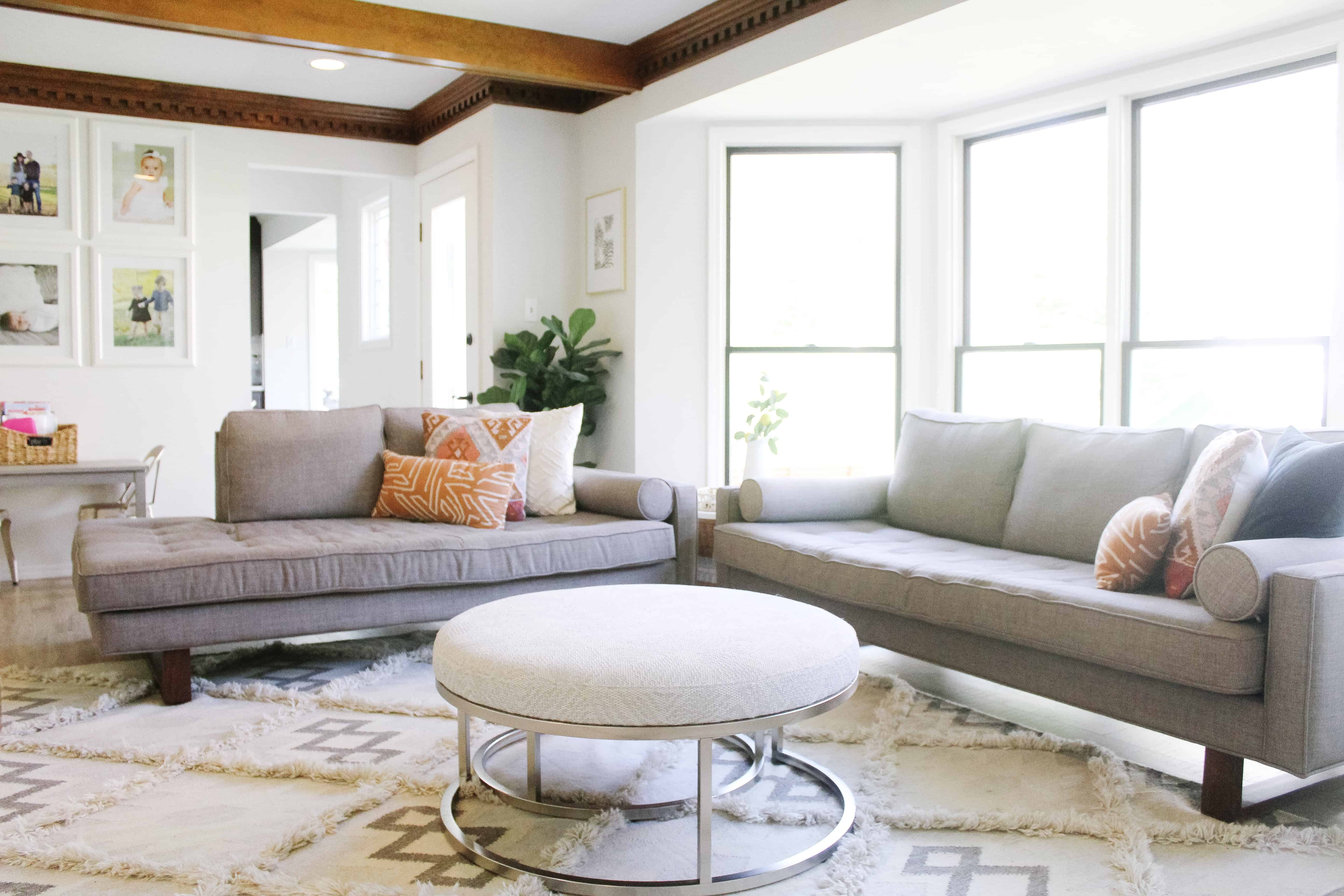 a view of a living room with midcentury modern grey couches