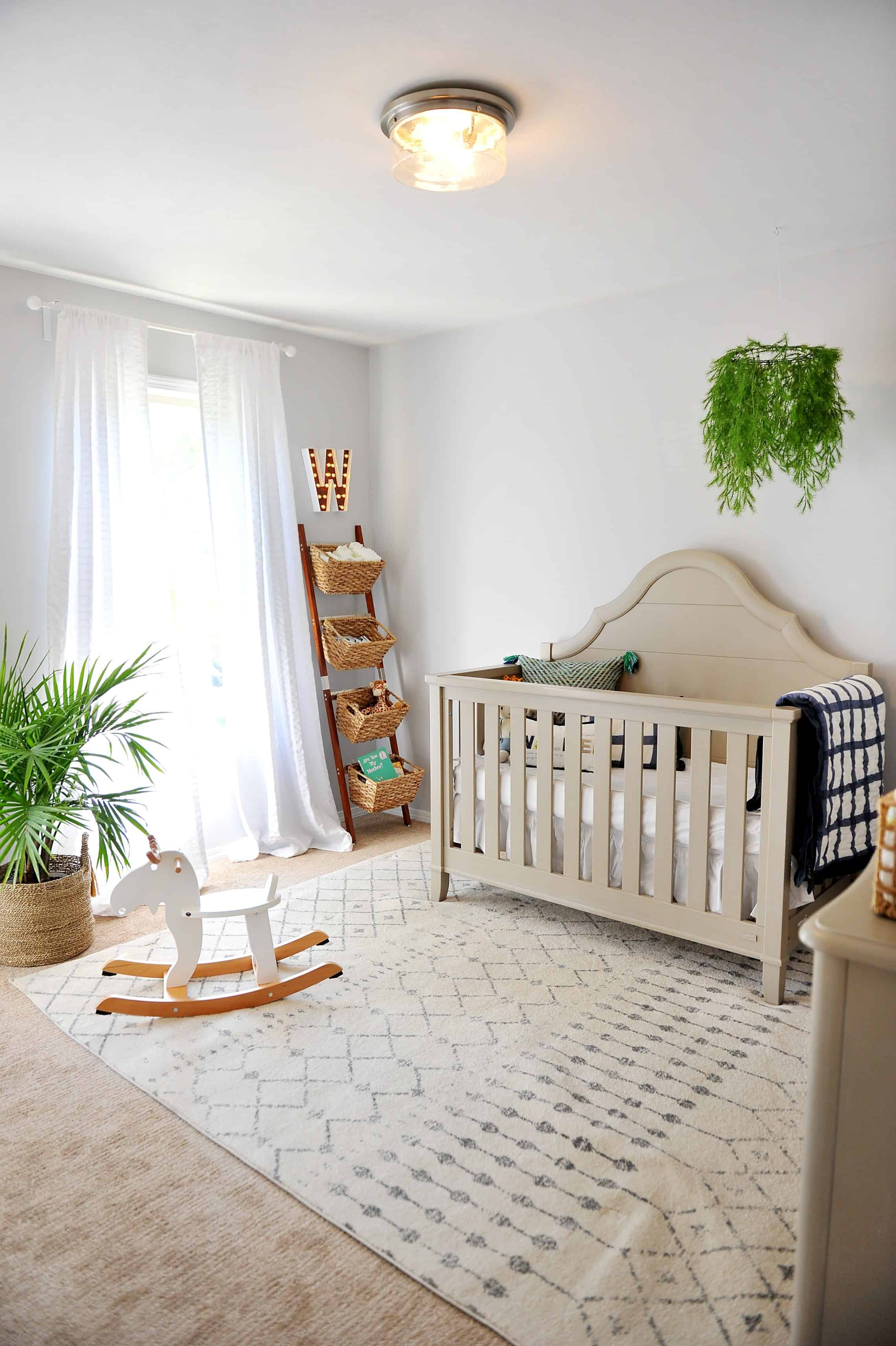 modern neutral nursery with pops of green and navy