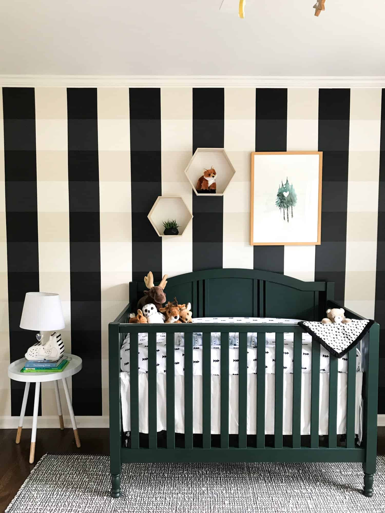 Black gingham wall in nursery behind black crib