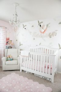 Floral wall in nursery with blush accents