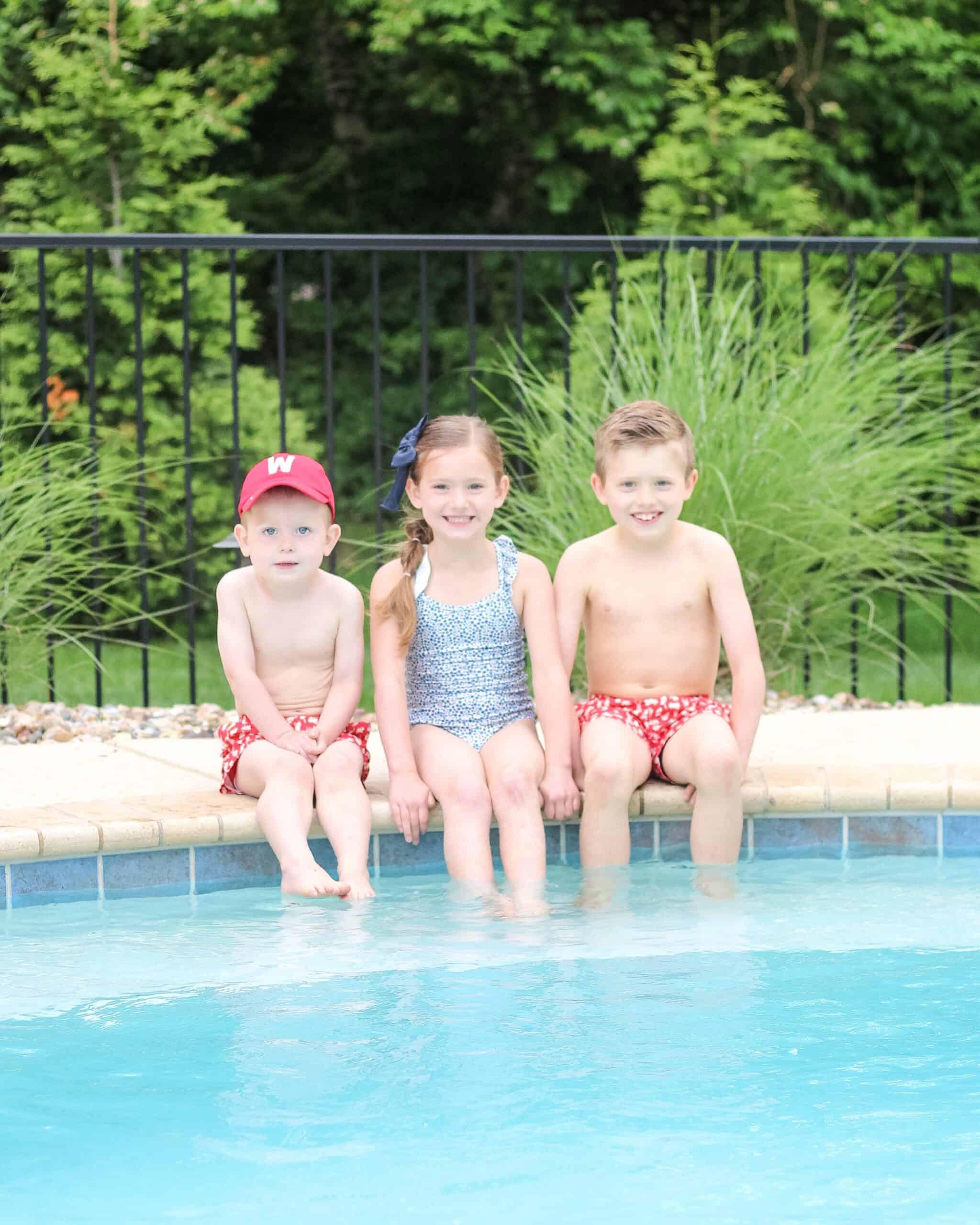 siblings in patriotic swimsuits