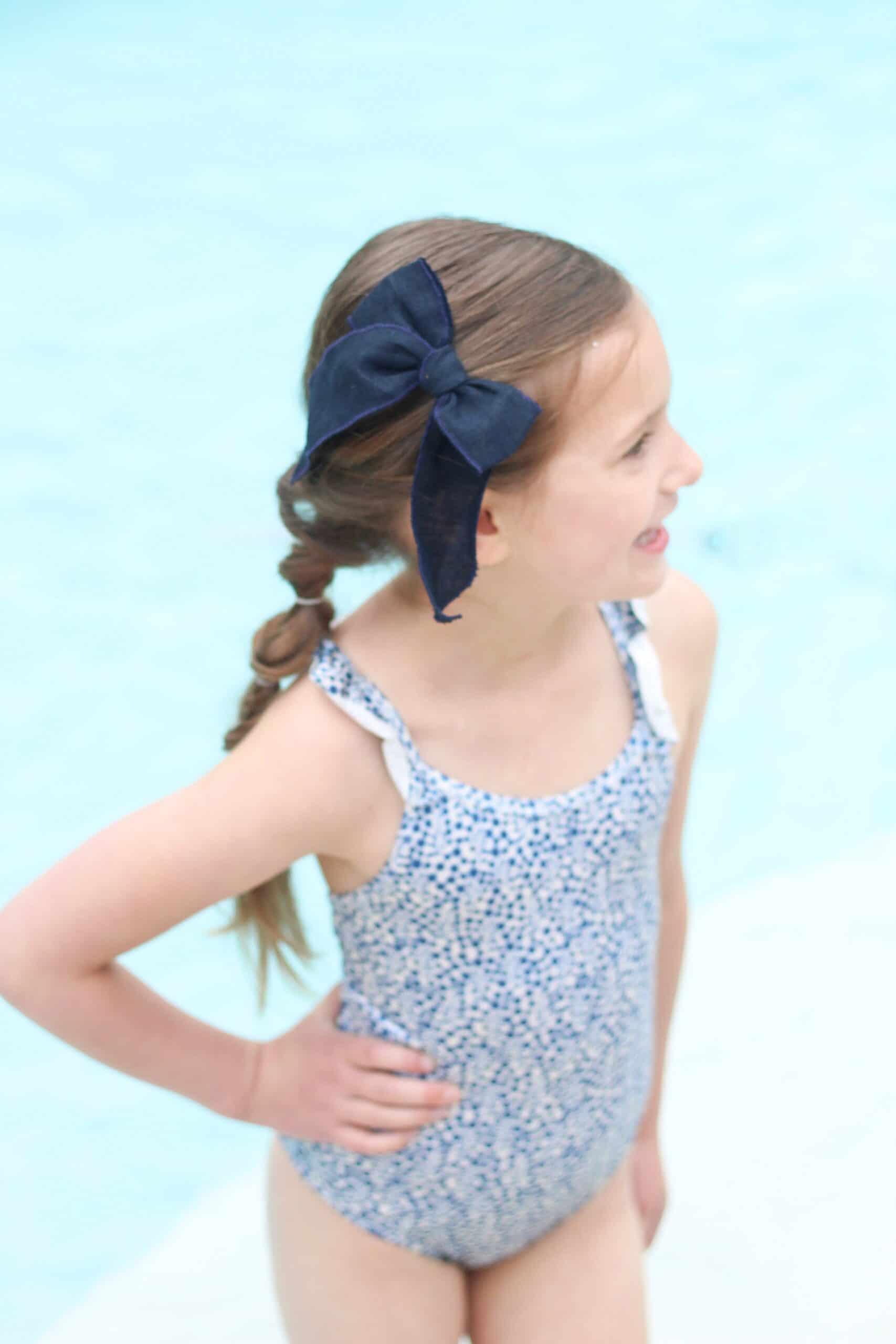 toddler girl in blue swimsuit